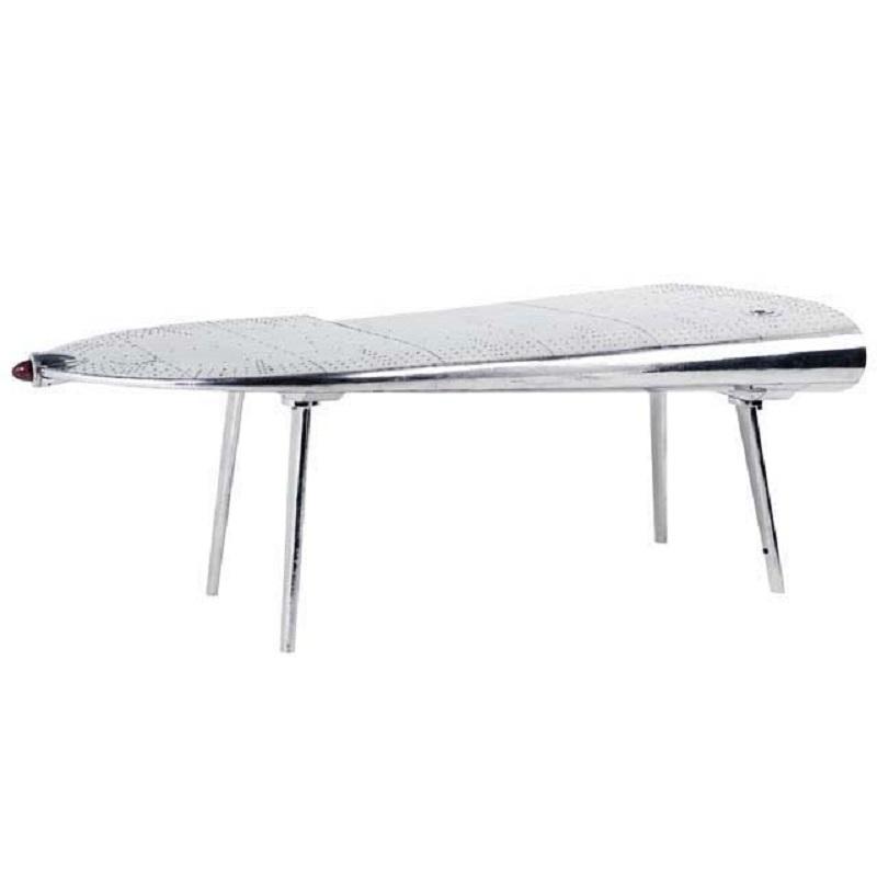 СтолПисьменные столы<br>Письменный стол Desk Wing Right с оригинальным дизайном в виде крыла самолета. Стол выполнен из полированного алюминия.<br><br>Material: Металл<br>Ширина см: 214.0<br>Высота см: 80.0<br>Глубина см: 110.0