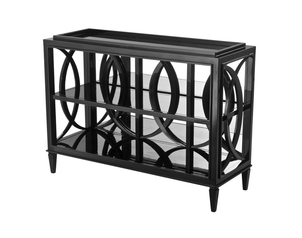 Консоль Cabinet ForsytheИнтерьерные консоли<br>Стеллаж Cabinet Forsythe выполнен из дерева черного цвета. Полки из плотного зеркального стекла.<br><br>Material: Дерево<br>Ширина см: 124.0<br>Высота см: 90.0<br>Глубина см: 46.0