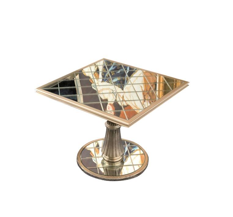 Квадратный столик FlorenceПриставные столики<br>Квадратный столик из дерева в стиле ар-деко, покрытый сусальным серебром. Столешница и основание ножки декорированы зеркальным стеклом, разбитым на маленькие квадраты.<br><br>Материал:<br>Столешница - зеркало.<br>Ножка и основание в отделке сусальное серебро<br><br>Material: Дерево<br>Length см: 65<br>Width см: 65<br>Height см: 51