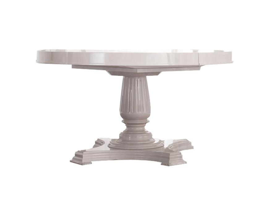 Раздвижной обеденный стол RiminiОбеденные столы<br>Круглая столешница опирается на резную массивную ножку с фигурным основанием. Максимальная ширина - 175 см. Отделка: белый блестящий лак.<br><br>Material: Дерево<br>Length см: None<br>Width см: None<br>Height см: 75<br>Diameter см: 135