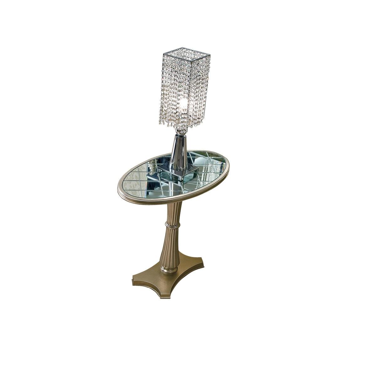 Столик FlorenceПриставные столики<br>Небольшой придиванный столик выполнен из дерева и покрыт сусальным серебром. Столешница выложена зеркальной мозаикой. Основание оригинальной формы и ножка в виде перехваченного посередине снопа.<br><br>Material: Дерево<br>Ширина см: 80.0<br>Высота см: 72.0<br>Глубина см: 45.0