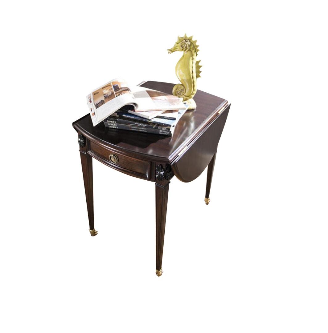 Журнальный столик MestreЖурнальные столики<br>Изящный стройный предмет мебели можно использовать как придиванную тумбу. Но расправив полукруглые крылья, он превращается в овальный журнальный стол. Дорогая отделка шпоном махагона и благородные металлические элементы.<br><br>Material: МДФ<br>Length см: 54<br>Width см: 75<br>Height см: 72
