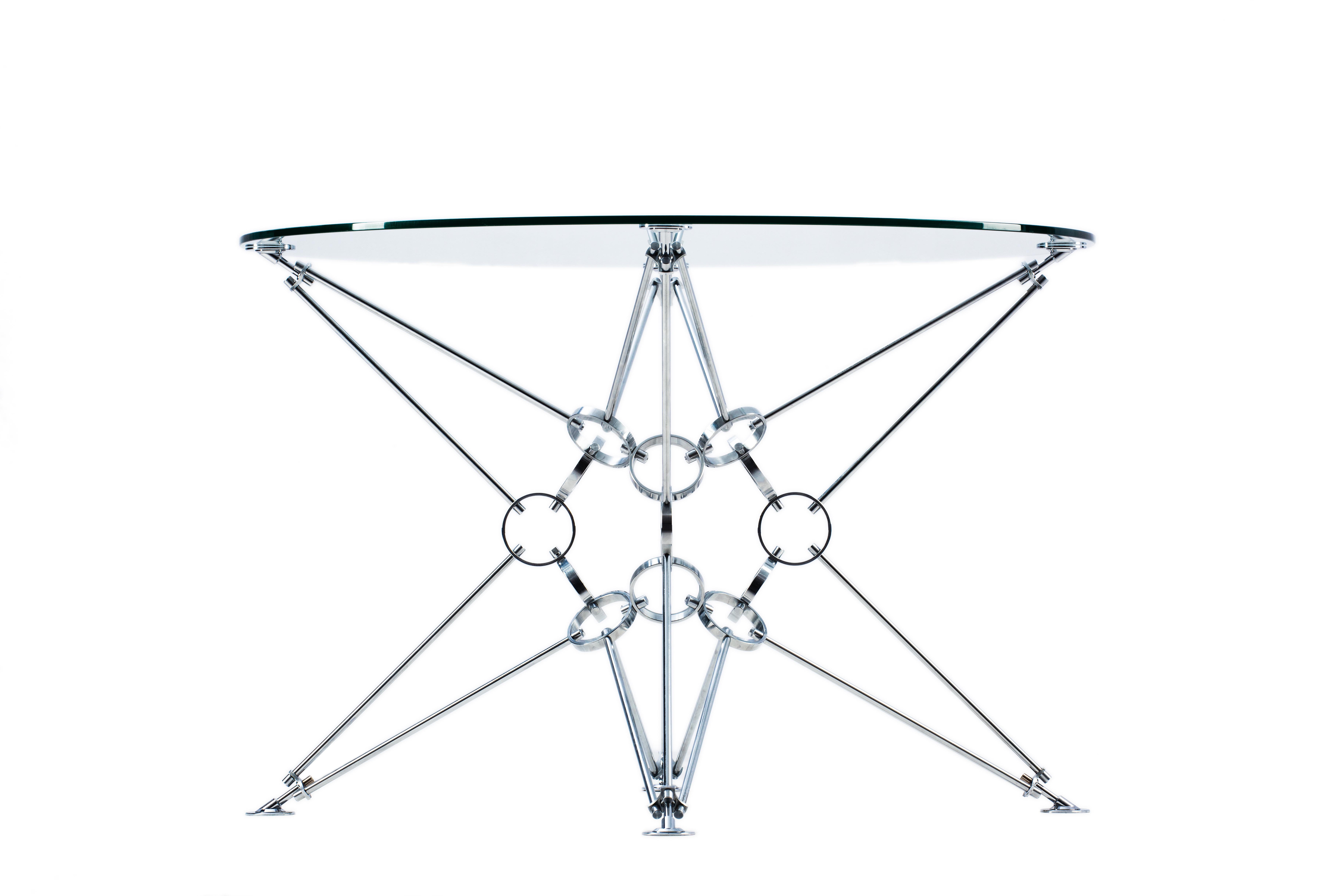 Стол 8 пирамид OptiwhiteОбеденные столы<br>&amp;lt;div&amp;gt;&amp;lt;span style=&amp;quot;font-size: 14px;&amp;quot;&amp;gt;&amp;quot;8 пирамид&amp;quot; – это модель космической архитектуры. Дизайнер Александр Новичков вдохновлялся идеей превращения куба в шар, что привело к созданию этой модели. Стол и его несущий модуль выполнены в стиле конструктивизма, дизайн минималистичен. В центре конструкции стола расположено ядро, на которое установлено 8 пирамид. Благодаря такому каркасу достигается высокая прочность и устойчивость. Конструкция модели полностью симметрична и похожа на звезду. Она не имеет ни верха, ни низа, что характерно для космического пространства.&amp;amp;nbsp;&amp;lt;/span&amp;gt;&amp;lt;span style=&amp;quot;font-size: 14px;&amp;quot;&amp;gt;Столы изготавливаются из натуральных материалов - &amp;amp;nbsp;цвет и фактура могут незначительно отличаться от представленных на фото.&amp;amp;nbsp;&amp;lt;/span&amp;gt;&amp;lt;span style=&amp;quot;font-size: 14px;&amp;quot;&amp;gt;Размеры стекла могут быть различными на заказ.&amp;amp;nbsp;&amp;lt;/span&amp;gt;&amp;lt;br&amp;gt;&amp;lt;/div&amp;gt;&amp;lt;div&amp;gt;&amp;lt;br&amp;gt;&amp;lt;/div&amp;gt;&amp;lt;div&amp;gt;Материал столешницы: стекло закаленное, толщина 10 м,&amp;amp;nbsp;Optiwhite.&amp;lt;div&amp;gt;Материал основания: хромированная сталь.&amp;lt;/div&amp;gt;&amp;lt;/div&amp;gt;&amp;lt;div&amp;gt;&amp;lt;/div&amp;gt;<br><br>Material: Стекло<br>Height см: 73<br>Diameter см: 110