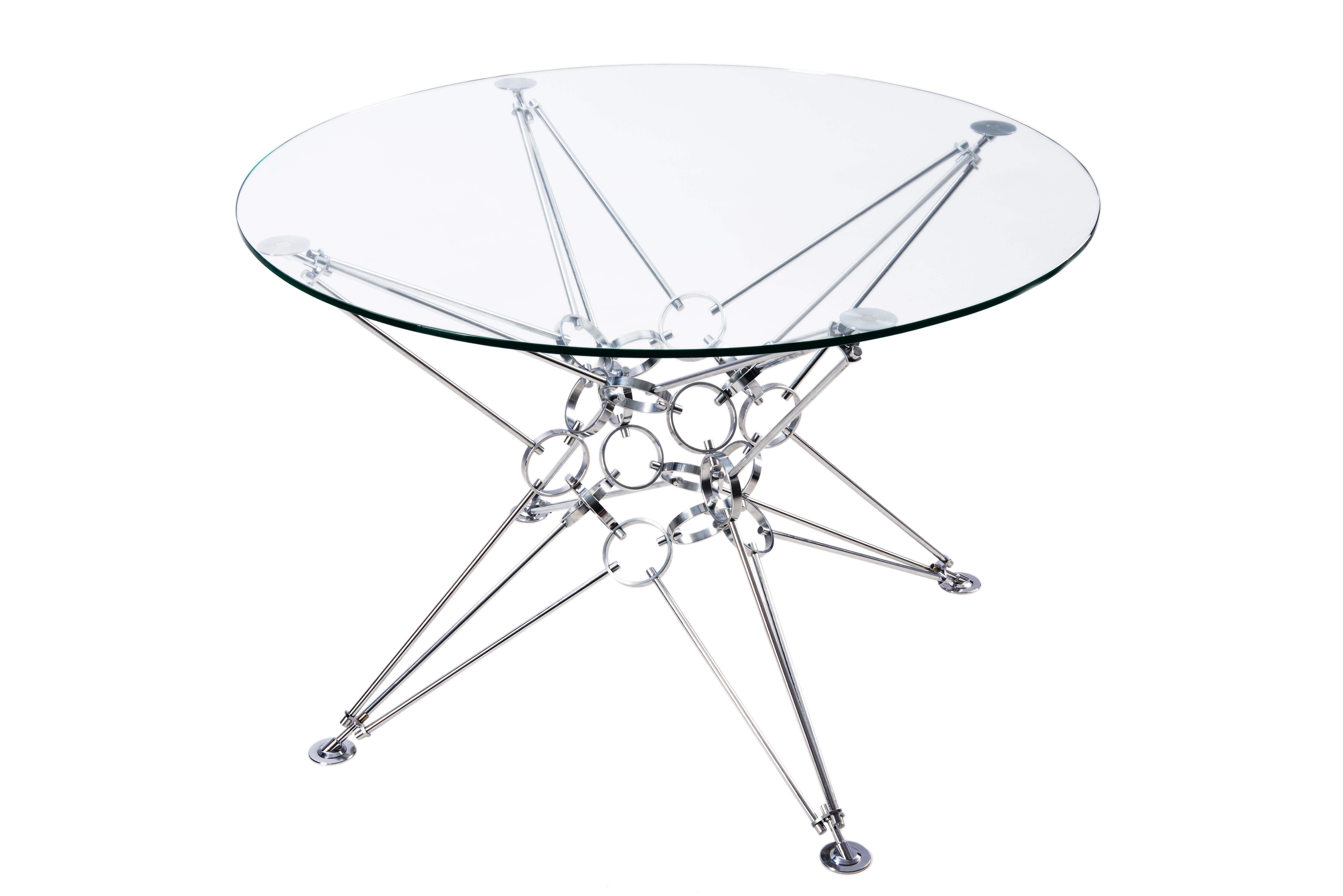 Стол 8 пирамидОбеденные столы<br>&amp;lt;div&amp;gt;&amp;lt;span style=&amp;quot;font-size: 14px;&amp;quot;&amp;gt;&amp;quot;8 пирамид&amp;quot; – это модель космической архитектуры. Дизайнер Александр Новичков вдохновлялся идеей превращения куба в шар, что привело к созданию этой модели. Стол и его несущий модуль выполнены в стиле конструктивизма, дизайн минималистичен. В центре конструкции стола расположено ядро, на которое установлено 8 пирамид. Благодаря такому каркасу достигается высокая прочность и устойчивость. Конструкция модели полностью симметрична и похожа на звезду. Она не имеет ни верха, ни низа, что характерно для космического пространства.&amp;amp;nbsp;&amp;lt;/span&amp;gt;&amp;lt;span style=&amp;quot;font-size: 14px;&amp;quot;&amp;gt;Столы изготавливаются из натуральных материалов - &amp;amp;nbsp;цвет и фактура могут незначительно отличаться от представленных на фото.&amp;amp;nbsp;&amp;lt;/span&amp;gt;&amp;lt;span style=&amp;quot;font-size: 14px;&amp;quot;&amp;gt;Размеры стекла могут быть различными на заказ.&amp;amp;nbsp;&amp;lt;/span&amp;gt;&amp;lt;br&amp;gt;&amp;lt;/div&amp;gt;&amp;lt;div&amp;gt;&amp;lt;br&amp;gt;&amp;lt;/div&amp;gt;&amp;lt;div&amp;gt;Материал столешницы: стекло закаленное, толщина 10 мм.&amp;lt;div&amp;gt;Материал основания: хромированная сталь.&amp;lt;/div&amp;gt;&amp;lt;/div&amp;gt;&amp;lt;div&amp;gt;&amp;lt;/div&amp;gt;<br><br>Material: Стекло<br>Height см: 74<br>Diameter см: 110