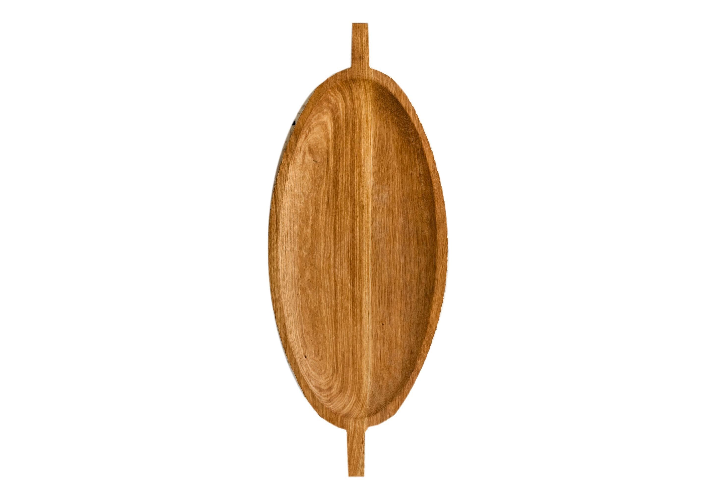 ПодносДекоративные подносы<br>Поднос служит большим сервировочным блюдом или крупным предметом-акцентом в декоре стола. Его можно использовать как полку или столешницу, а несколько подносов, поставленных друг на друга, составляют журнальный столик или тумбу. Сделан вручную. Покрытие: льняное масло. При необходимости можно обновлять покрытие, протерев поверхность тряпочкой, смоченной льняным маслом. После влажной обработки его нужно протирать полотенцем. Из-за специфики ручного труда все предметы отличаются друг от друга.<br><br>Material: Дуб<br>Length см: 70<br>Width см: 30<br>Depth см: None<br>Height см: 1,5