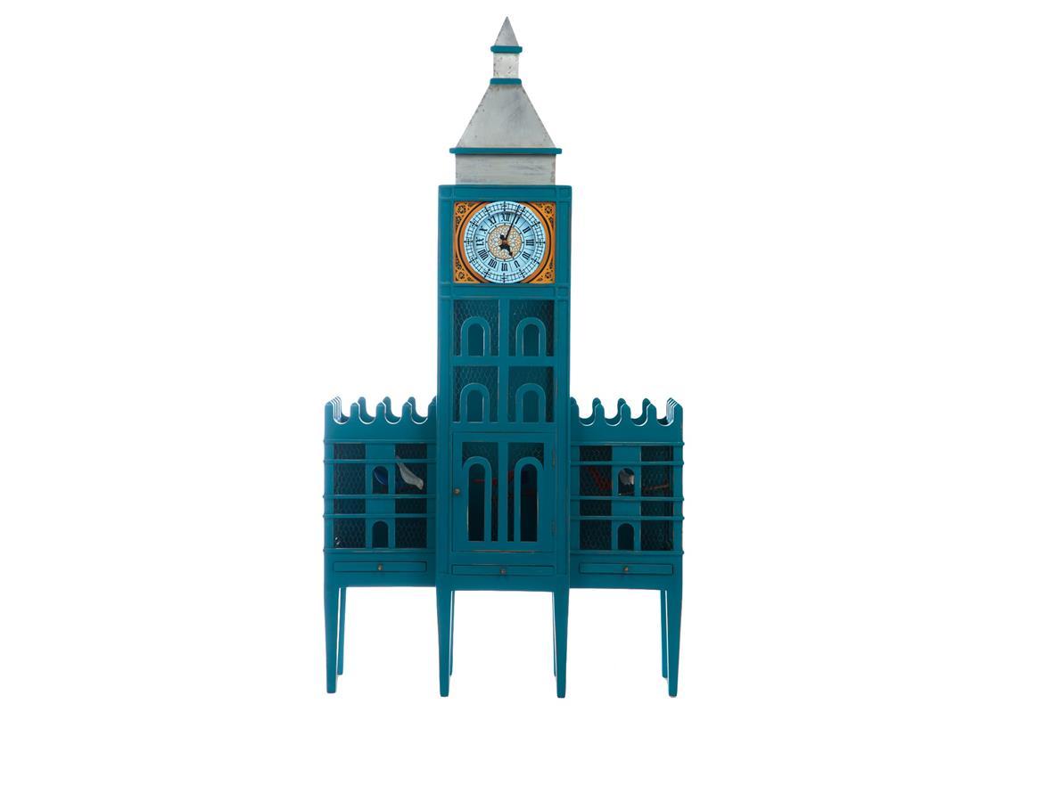 Шкаф игровойКнижные шкафы для детской<br>Шкаф игровой в виде клетки. Внутри деревянные птички на железных ветках. Центральное отделение открывается. Крыша башни обита железом, украшена росписью в виде часов.&amp;amp;nbsp;<br><br>Material: Красное дерево<br>Width см: 111<br>Depth см: 41<br>Height см: 210