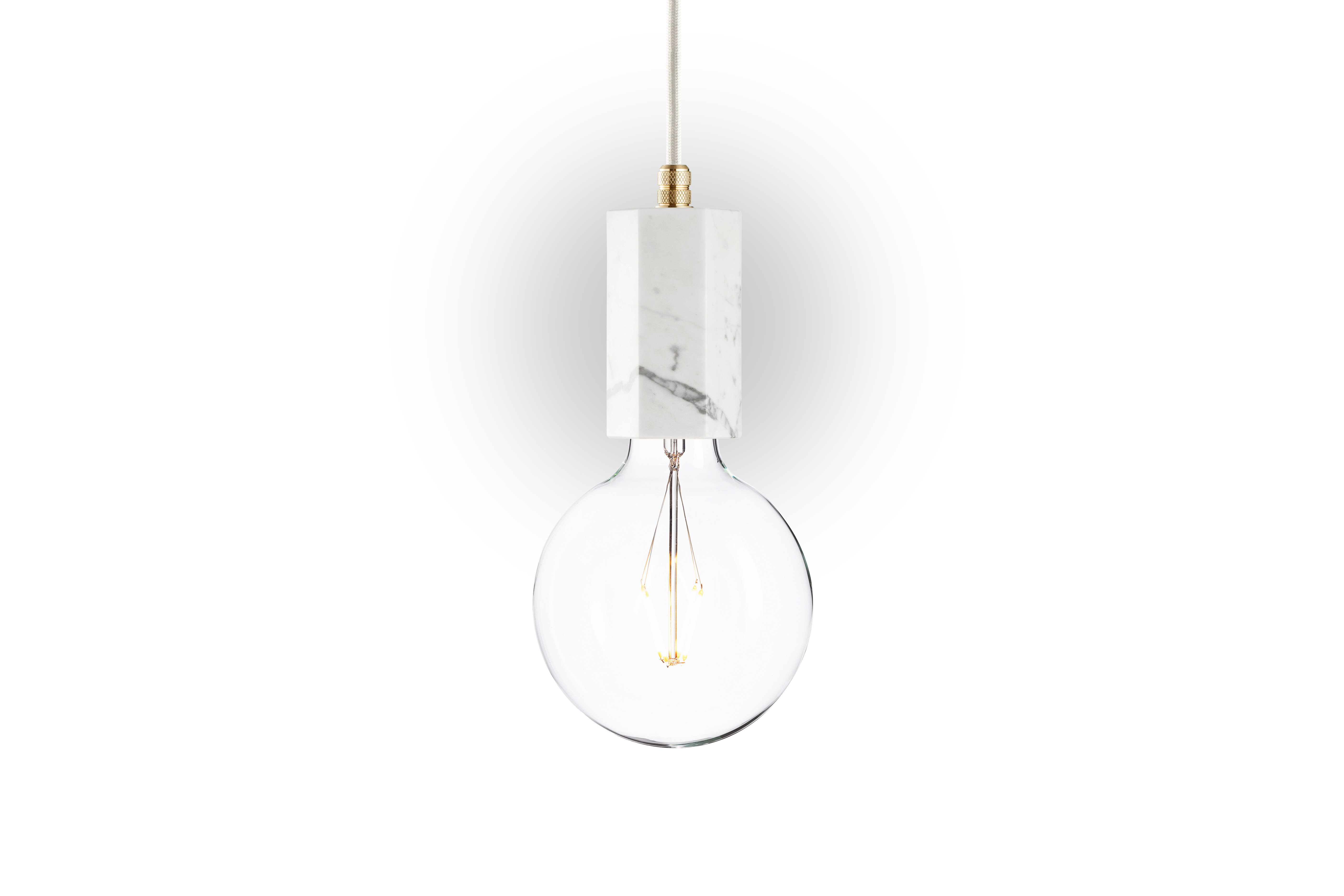 Подвесной светильник Marmor TromПодвесные светильники<br>Подвесной светильник &amp;quot;Marmor Trom&amp;quot; ? превосходный пример элегантного оформления, в котором простота встречается с роскошью. Строгая геометрия основания дарит лампе лоск минимализма. Изысканный узор настоящего белого мрамора позволяет светильнику в стиле лофт завораживать своей утонченностью каждого.&amp;lt;div&amp;gt;&amp;lt;br&amp;gt;&amp;lt;/div&amp;gt;&amp;lt;div&amp;gt;Лампочка приобретается отдельно. Цоколь Е27, максимальная мощность лампочки - 60 W, длина шнура - 3 м.&amp;amp;nbsp;&amp;amp;nbsp;&amp;lt;/div&amp;gt;&amp;lt;div&amp;gt;Материал: корпус - мрамор &amp;amp;nbsp;Bianco Carrara, фурнитура - латунь, сталь, патрон - пластик, кабель в оплетке. Под заказ. Срок изготовления 3 недели.&amp;amp;nbsp;&amp;lt;/div&amp;gt;<br><br>Material: Мрамор