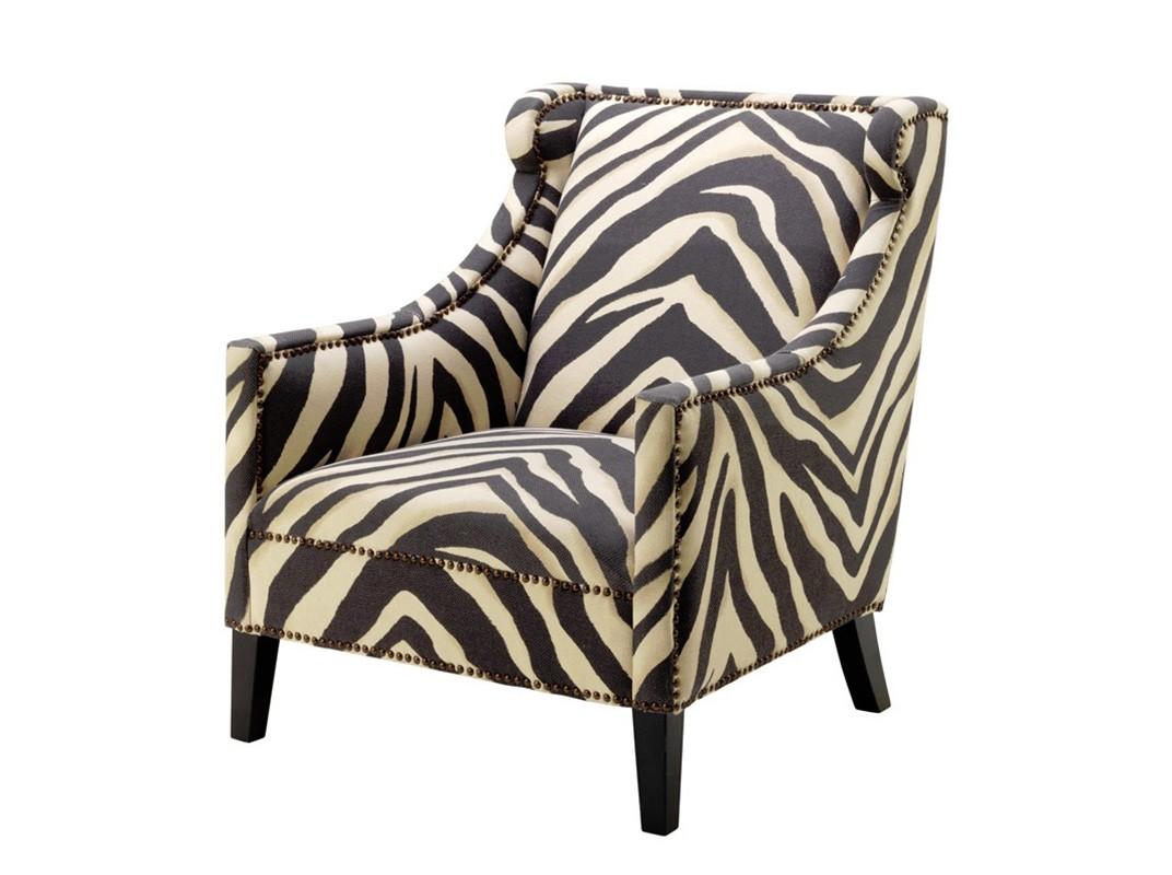Кресло ZebraИнтерьерные кресла<br>Кресло с подлокотниками Chair Jenner Zebra на деревянных черных ножках. Кресло обтянуто тканью с оригинальным рисунком &amp;quot;зебры&amp;quot; черно-белого цвета.<br><br>Material: Текстиль<br>Width см: 75<br>Depth см: 83<br>Height см: 90,5