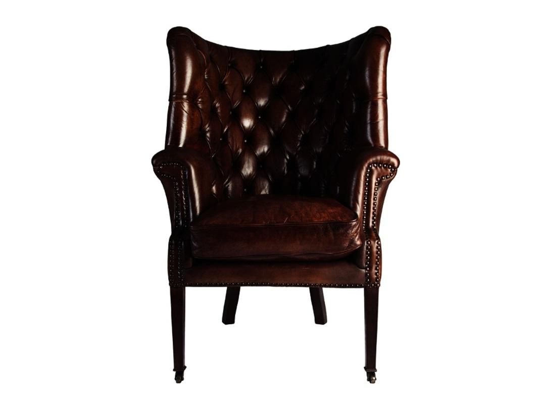 Кресло ЧерчильКожаные кресла<br>Кресло Черчиль - предмет обстановки интерьера, который расскажет о стиле своего владельца и подчеркнет его статус. Великолепная плотная глянцевая кожа, удобные подлокотники, продуманная сложная спинка, декорированная стежкой капитоне и небольшие колесики на передних ножках - все вместе создают предмет, который займет свое место в респектабельном рабочем кабинете, гостиной или домашней библиотеки.<br><br>Материал: массив дерева,<br>Обивка: натуральная кожа<br><br>Material: Кожа<br>Length см: 85<br>Width см: 81<br>Height см: 112