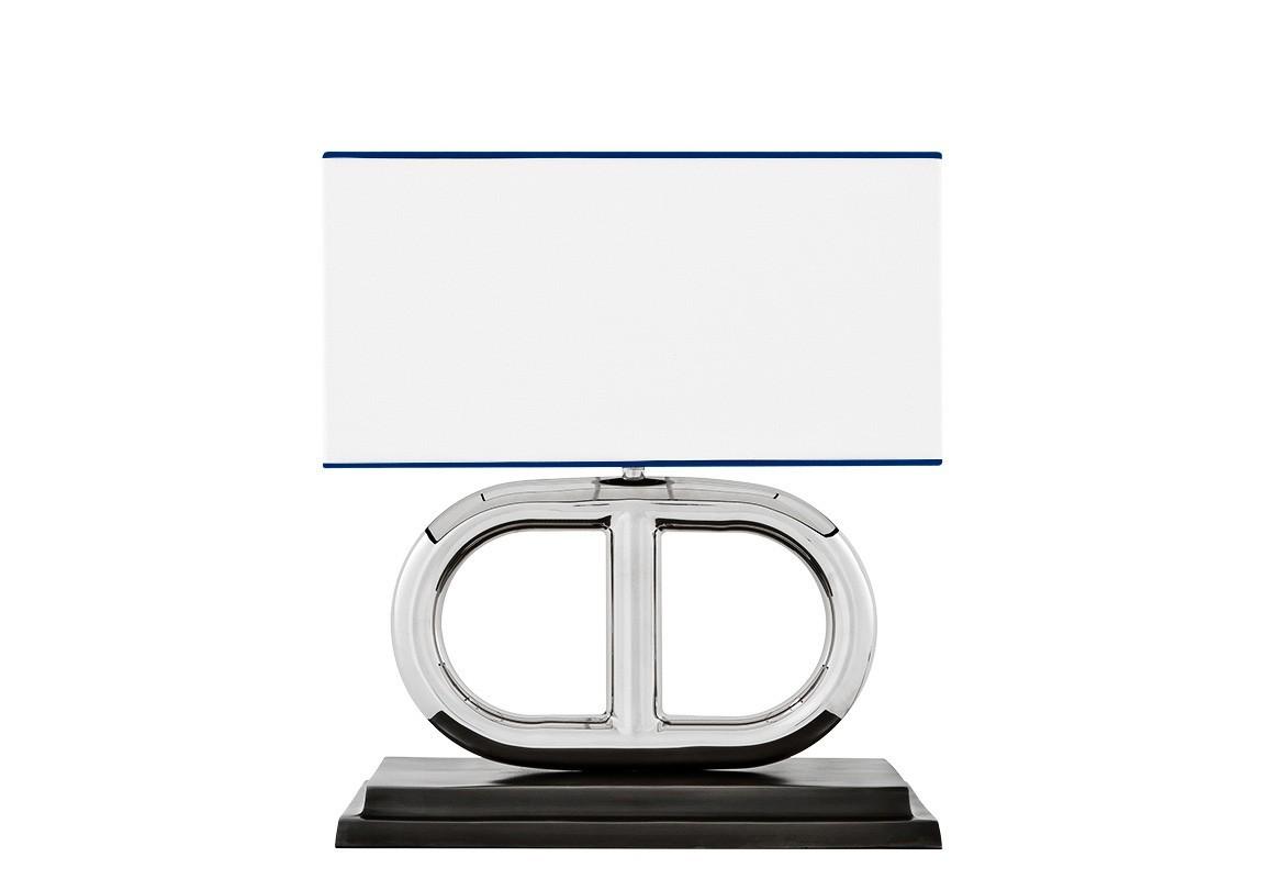 Настольная лампаДекоративные лампы<br>Настольная лампа Anguilla с текстильным абажуром белого цвета с синим кантом. Цвет арматуры - стальной. Подставка лампы выполнена из темного дерева.&amp;lt;div&amp;gt;&amp;lt;br&amp;gt;&amp;lt;/div&amp;gt;&amp;lt;div&amp;gt;&amp;lt;div&amp;gt;Цоколь: E27&amp;lt;/div&amp;gt;&amp;lt;div&amp;gt;Мощность: 40W&amp;lt;/div&amp;gt;&amp;lt;div&amp;gt;Количество ламп: 1&amp;lt;/div&amp;gt;&amp;lt;/div&amp;gt;<br><br>Material: Текстиль<br>Ширина см: 39<br>Высота см: 47<br>Глубина см: 21