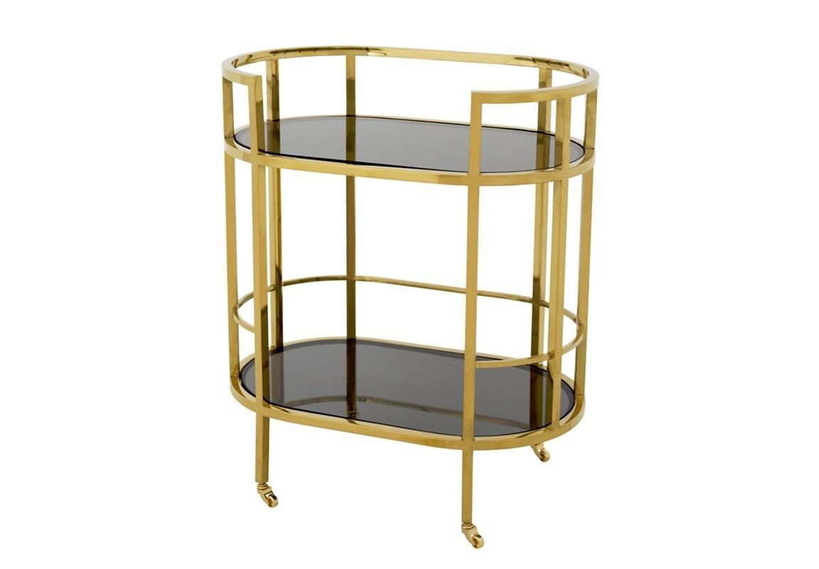 СтолСервировочные столики<br>Сервировочный столик на колесиках Trolley Townhouse с металлическим каркасом золотого цвета. Полки выполнены из плотного стекла дымчатого цвета.<br><br>Material: Металл<br>Width см: 70<br>Depth см: 43<br>Height см: 81