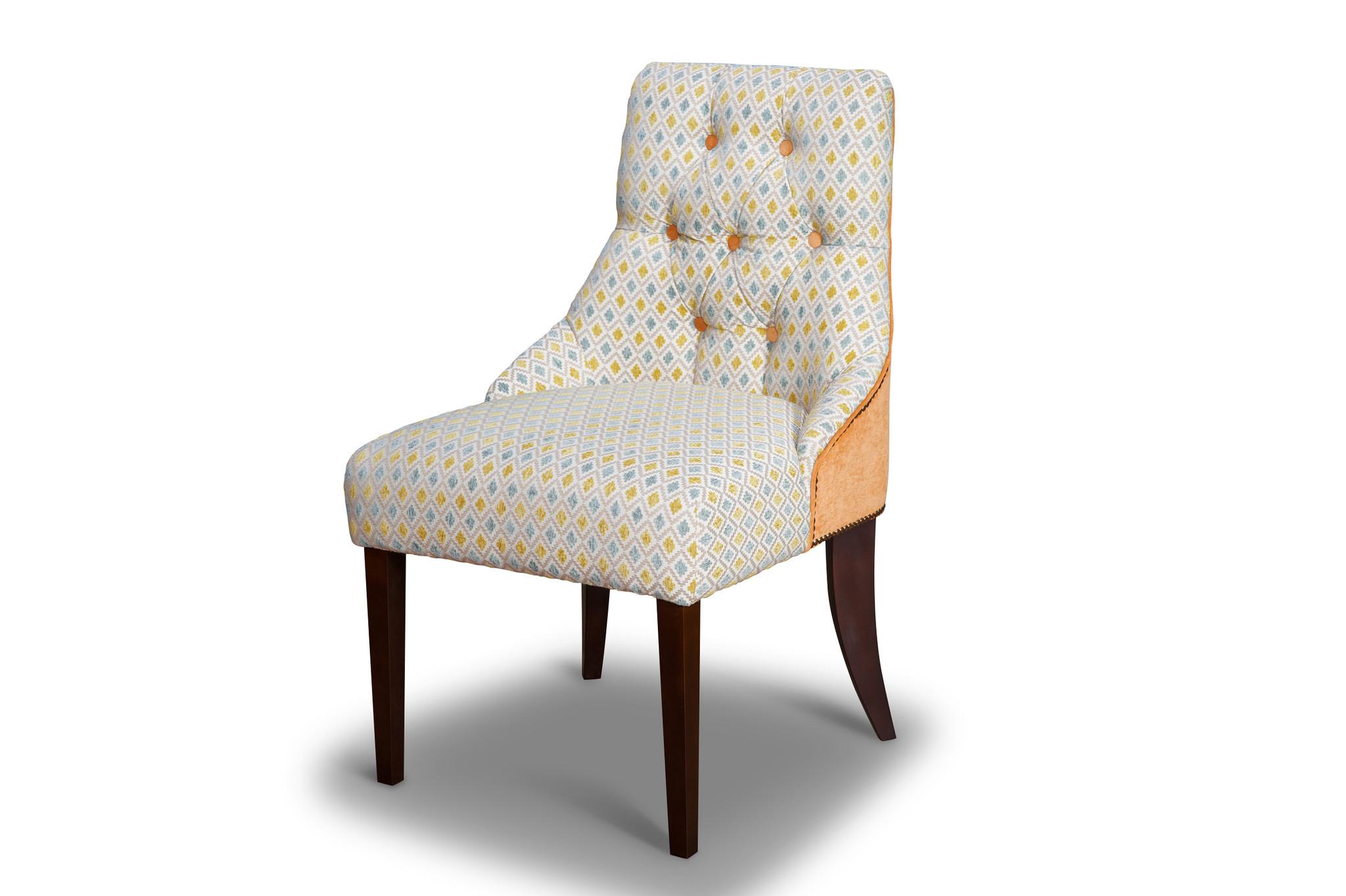 Стул МессиноОбеденные стулья<br>&amp;lt;div&amp;gt;Классический стул без подлокотников декорирован стежкой капитоне по внутренней части изогнутой спинки и гвоздевым декором по всему внешнему периметру.&amp;amp;nbsp;&amp;lt;/div&amp;gt;&amp;lt;div&amp;gt;&amp;lt;br&amp;gt;&amp;lt;/div&amp;gt;&amp;lt;div&amp;gt;Материал обивки: мягкая эластичная ткань или экокожа.&amp;amp;nbsp;&amp;lt;/div&amp;gt;&amp;lt;div&amp;gt;Наполнение: композиционный микс из резинотканных ремней, пенополиуретана и различной эластичности в термовлагозащитном чехле из материала &amp;quot;Hollgone&amp;quot;.&amp;lt;/div&amp;gt;&amp;lt;div&amp;gt;Материал каркаса: брус, фанера.&amp;amp;nbsp;&amp;lt;/div&amp;gt;&amp;lt;div&amp;gt;Особенность модели: спинка создана с плавным переходом в боковой уровень, что прекрасно заменяет подлокотники. Опция: выбор цвета гвоздевого декора: старое золото или никель в момент оформления заказа.&amp;amp;nbsp;&amp;lt;/div&amp;gt;&amp;lt;div&amp;gt;Опция: замена пуговиц стежки на стразы.&amp;amp;nbsp;&amp;lt;/div&amp;gt;&amp;lt;div&amp;gt;Изделие можно заказать в любой ткани: стоимость и срок изготовления уточняйте у менеджера.&amp;lt;/div&amp;gt;<br><br>Material: Текстиль<br>Width см: 63<br>Depth см: 56<br>Height см: 95
