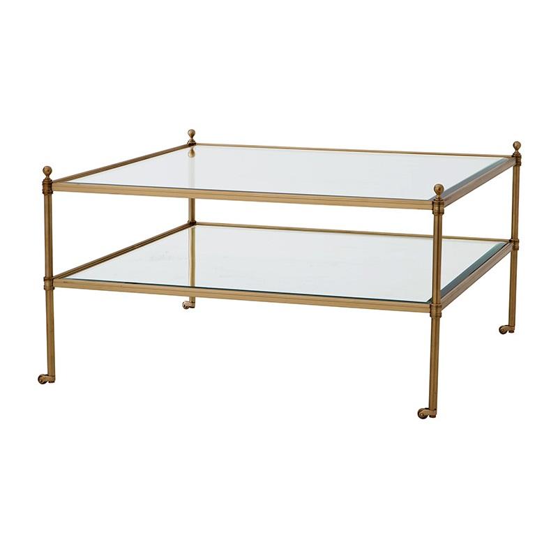 Журнальный столикЖурнальные столики<br>Журнальный столик Coffee Table Aubrey на металлическом основании цвета латунь. Столешница и полка из прозрачного стекла.<br><br>Material: Стекло<br>Width см: 78<br>Depth см: 78<br>Height см: 44
