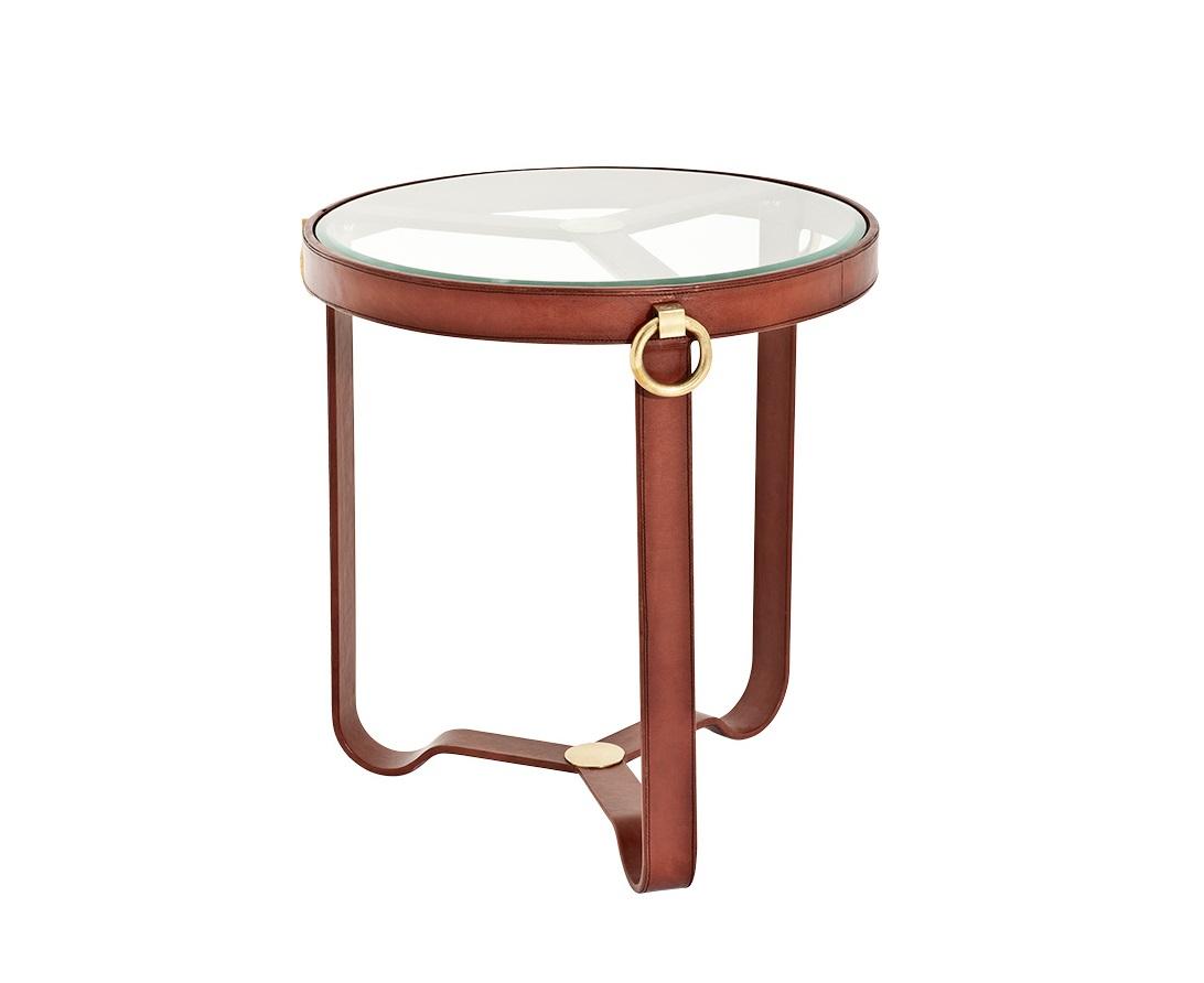 СтолПриставные столики<br>Столик Side Belgravia с металлическими ножками, обтянутыми кожей коньячного цвета. Столешница из плотного прозрачного стекла. Цвет металла: античная латунь.<br><br>Material: Кожа<br>Высота см: 60
