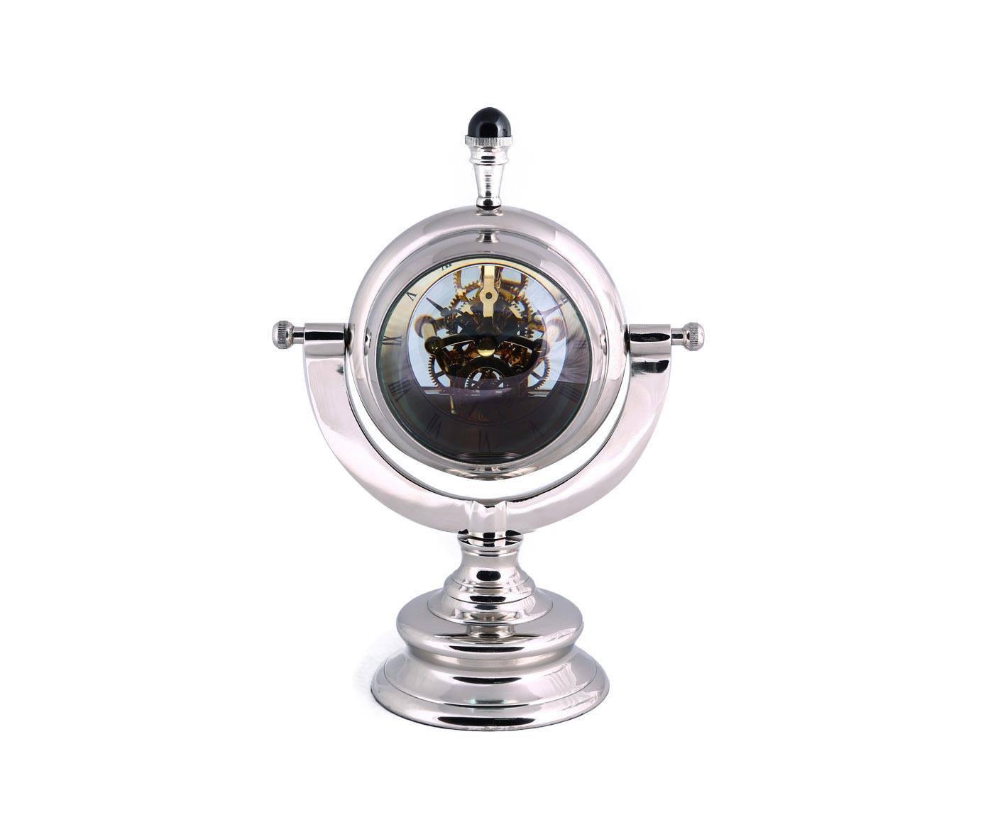 Настольные часы ЛиотоНастольные часы<br>Привлекательный внешний облик настольных часов Лиото точно не останется без внимания. Это не просто полезный и практичный аксессуар для Вашего дома. Это футуристическая диковинка, необычная вещица с космическим дизайном, захватывающим воображение. Ультрамодные и винтажные одновременно - современные настольные часы радуют глаз и украшают интерьер. Прозрачный корпус позволяет рассмотреть движение механизма.<br><br>Необычные часы - это не только оригинальный аксессуар, но и универсальный подарок. С появлением такого элемента интерьера Ваш дом преображается и становится совершенно особенным. Неординарный дизайн часов порадует любителей красивых и стильных подарков.<br><br>Material: Металл<br>Width см: 23<br>Depth см: 14<br>Height см: 32