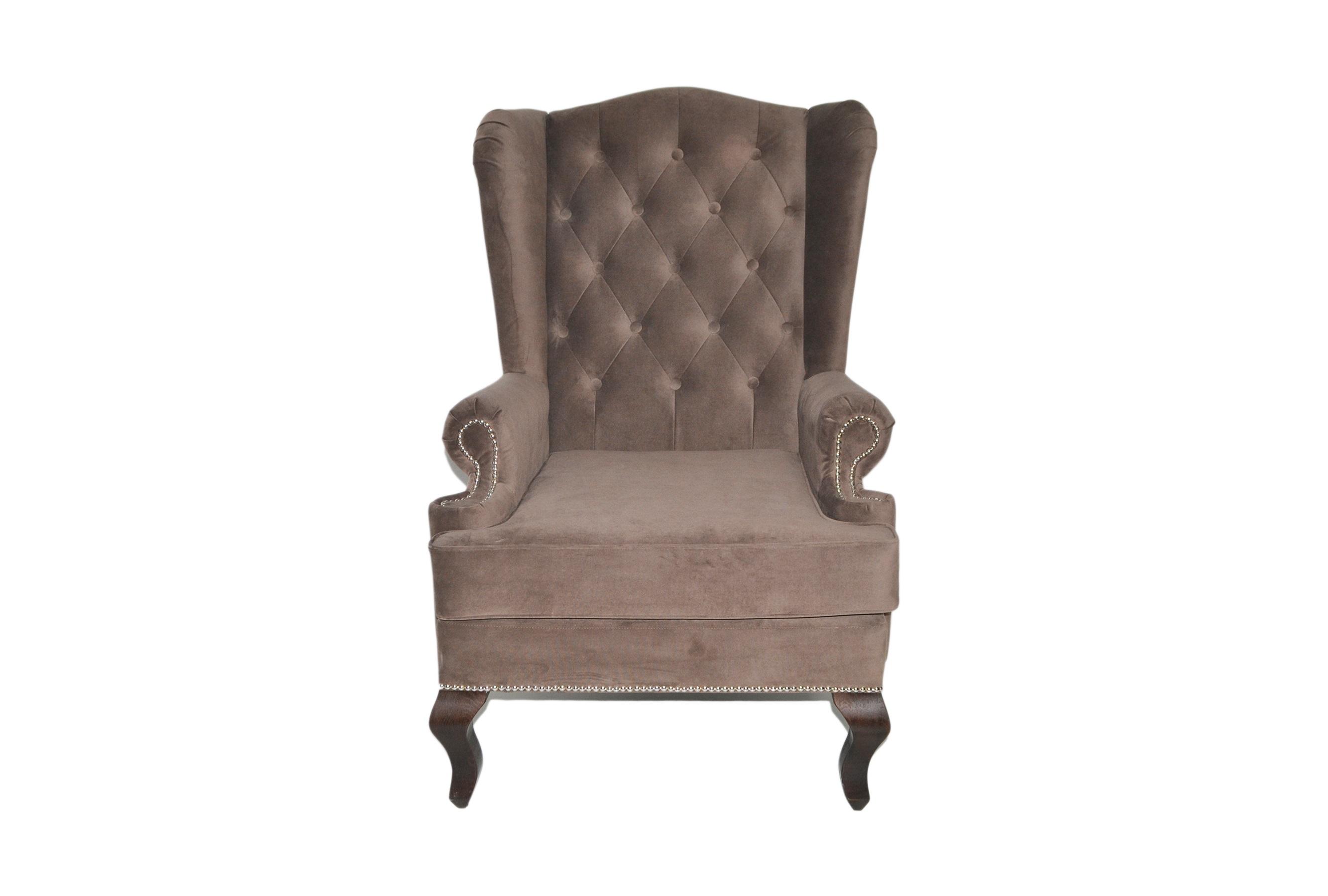 Каминное креслоКресла с высокой спинкой<br>Каминное кресло – мягкий предмет мебели повышенной комфортности с высокой спинкой, оно рассчитано на отдых возле домашнего очага. Его конструкция, как и много лет назад, почти не изменилась.<br>Каминное кресло с ушами (выступами на уровне головы), имеет каркас из дерева, гнутые ножки и мягкие подлокотники. Впервые такую модель сделали в Англии в XVII веке. Пожилых людей своеобразные крылья уберегали от сквозняков, в гостиной они предохраняли от залетания искр из камина. Отсюда появилось название такой модели – каминное кресло в английском стиле. Еще оно именуется на родине «крылатым», «дедушкиным».<br><br>Material: Велюр<br>Length см: None<br>Width см: 73<br>Depth см: 70<br>Height см: 110