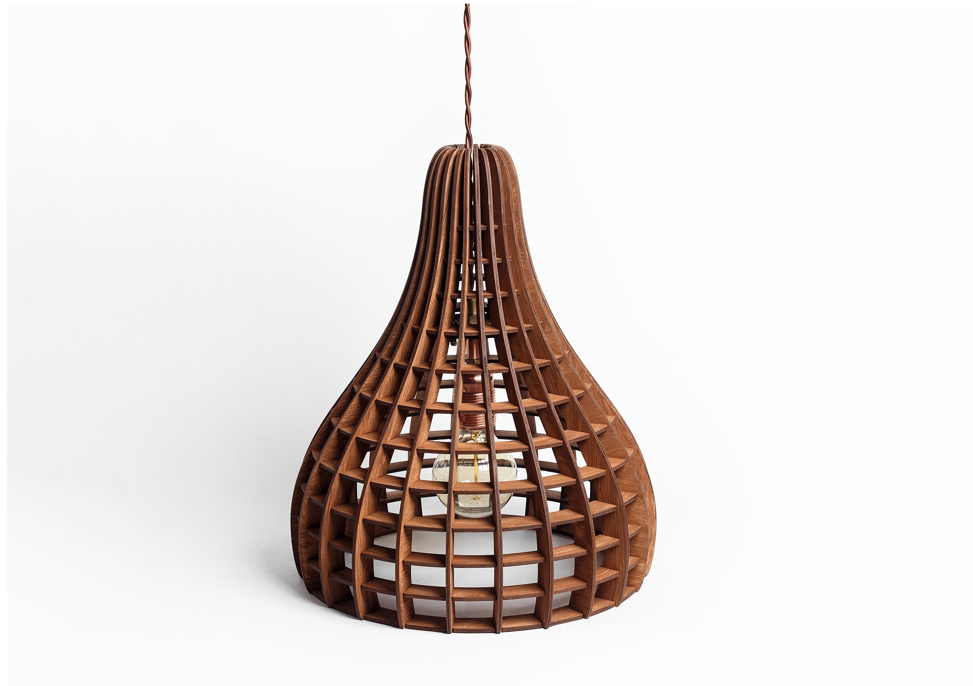 Деревянный светильник ВулканПодвесные светильники<br>Деревянная люстра в стиле Лофт. Возможно изготовление в двух цветах - натуральный ( покрытый лаком ) и темный ( мореный ) Поставляется в собранном виде.&amp;amp;nbsp;&amp;lt;div&amp;gt;&amp;lt;br&amp;gt;&amp;lt;/div&amp;gt;&amp;lt;div&amp;gt;&amp;lt;div&amp;gt;Вид цоколя: E27&amp;lt;/div&amp;gt;&amp;lt;div&amp;gt;Мощность: 60W&amp;lt;/div&amp;gt;&amp;lt;div&amp;gt;Количество ламп: 1 (нет в комплекте)&amp;lt;/div&amp;gt;&amp;lt;/div&amp;gt;<br><br>Material: Дерево<br>Length см: None<br>Width см: None<br>Height см: 40<br>Diameter см: 34