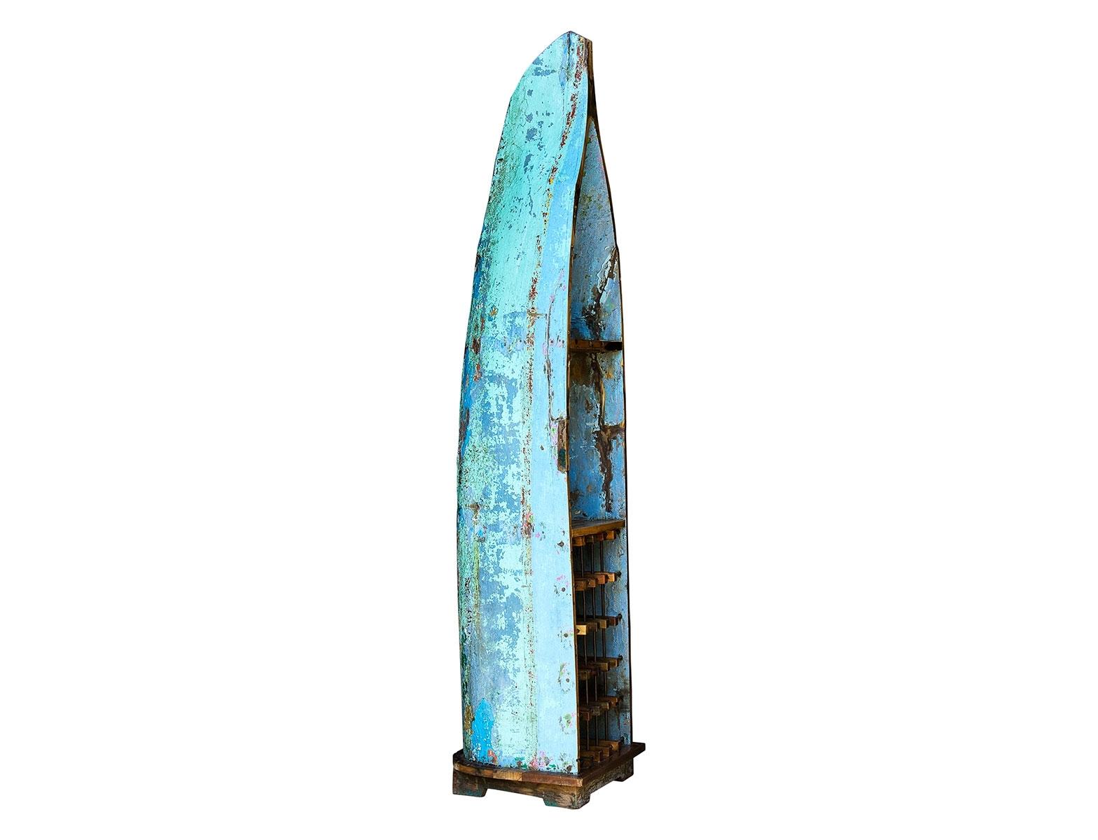 Лодка для вина ЛаперузВинные стеллажи<br>Винный шкаф, выполненный из старой рыбацкой лодки классической правильной формы с сохранением оригинальной многослойной окраски.<br><br>Хранит до 15 бутылок.<br>Подходит для использования как внутри помещения, так и снаружи.<br>Сборка не требуется.<br><br>Material: Тик<br>Width см: 58<br>Depth см: 48<br>Height см: 225