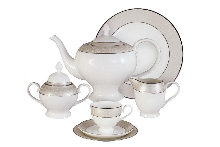 Чайный сервиз 40 предметов на 12 персон АнтуанеттаЧайные сервизы<br>В комплект входят: 12 десерт тарелок 18 см; 12 чашек 0,2л; 12 блюдец, сливочник 0,3л; чайник1,5л; сахарница 0,35л; блюдо для торта 31 см.<br><br>Material: Фарфор