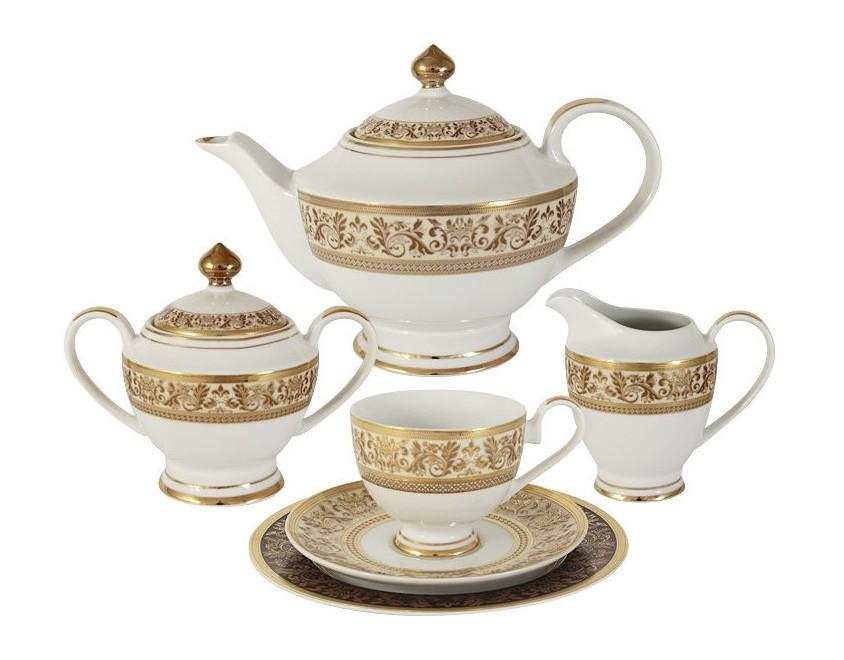 Чайный сервиз 23 предмета на 6 персон ТриумфЧайные сервизы<br>В комплект входят: 6 чашек 0,2л,6 блюдец,6 тарелок 19см, чайник с крышкой 1,4л, сахарница с крышкой 0,45л, сливочник 0,3л.<br><br>Material: Фарфор