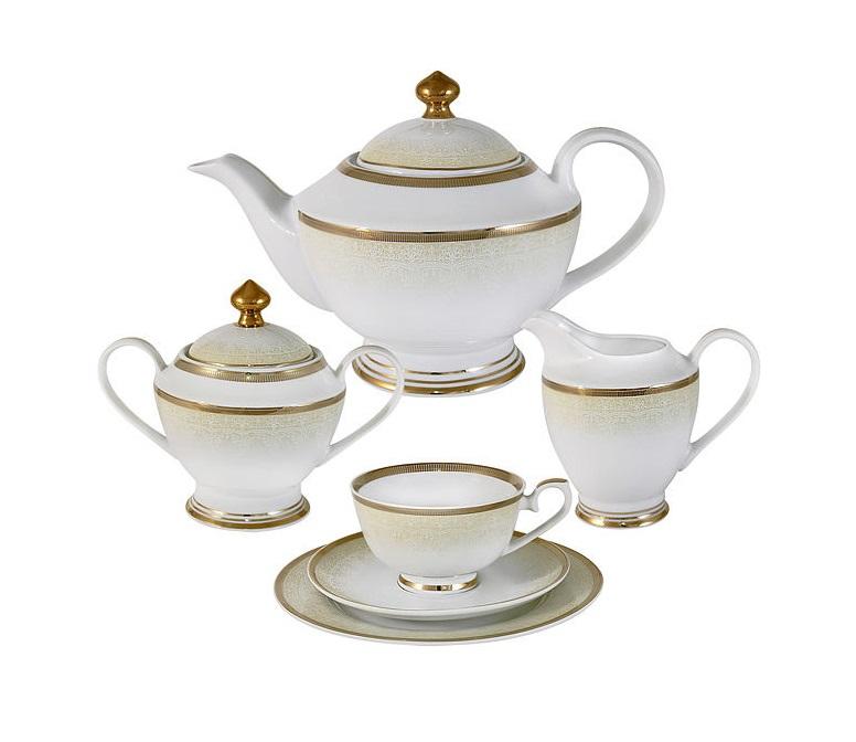 Чайный сервиз 23 предмета на 6 персон Вуаль кремоваяЧайные сервизы<br>В комплект входят: &amp;amp;nbsp;6 чашек 0,2л,6 блюдец,6 тарелок 19см, чайник с крышкой 1,35л, сахарница с крышкой 0,35л, сливочник 0,3л.<br><br>Material: Фарфор