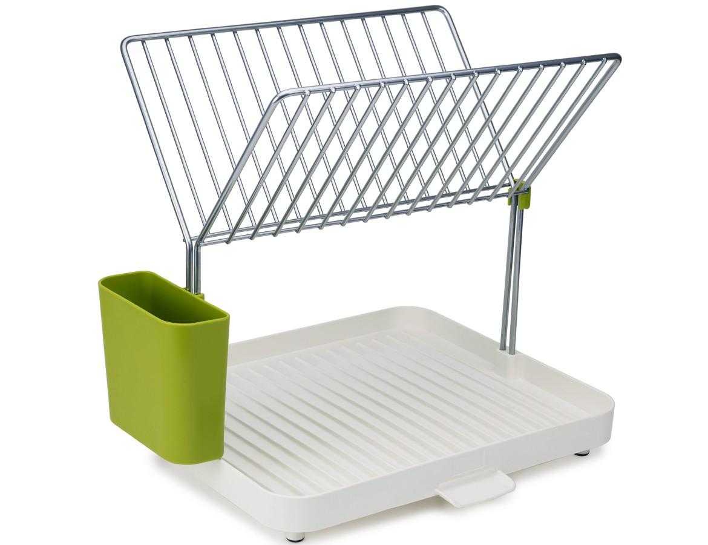 Сушилка для посудыАксессуары для кухни<br>Эргономичная сушилка для посуды, позволяющая сэкономить место на кухне. Двухуровневая конструкция состоит из устойчивого основания для кастрюль, сковородок и чашек и из верхней решетки, вмещающей до 15 тарелок и блюдец. Объемное отделение со сливом предоставляет возможность тщательно осушить до 4 комплектов посуды — и все это на минимальном участке пространства. Вода свободно стекает по желобкам, расположенным у основания под наклоном, а встроенный носик позволяет быстро сливать жидкость прямо в раковину. Нескользящие ножки обеспечивают устойчивость.  Конструкция разбирается на части для легкой очистки.&amp;amp;nbsp;<br><br>Material: Пластик<br>Width см: 30,4<br>Depth см: 28,2<br>Height см: 36,5