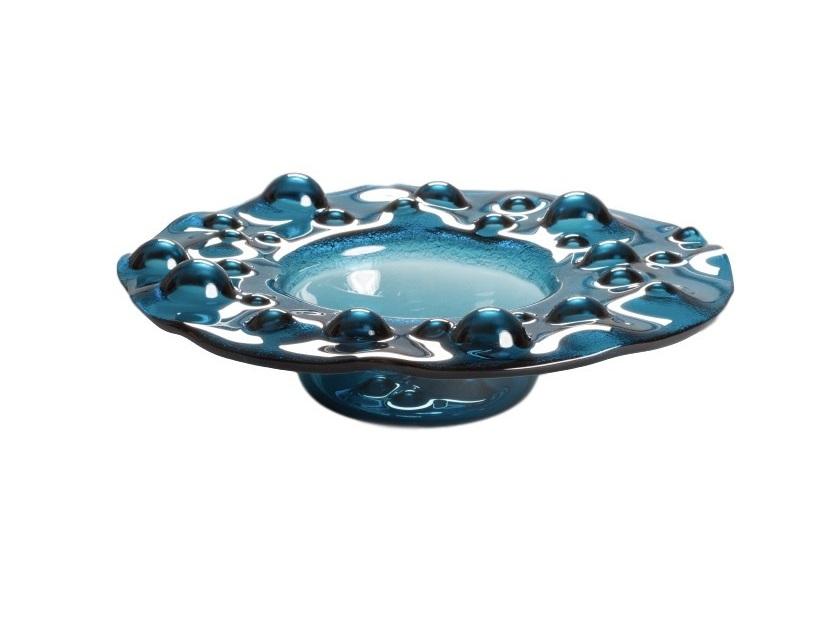 Ваза GeyzerДекоративные блюда<br>Переливы Geyser Blue не только успокаивают и завораживают, но и под разным углом освещения создается невероятный эффект преломления лучей, что вызывает эффект сияния изнутри. В арт-объекте от Plusobject можно рассмотреть водную стихию во всем ее величии, там есть и пенистые от шторма волны и интригующее, загадочное спокойствие великого океана.<br><br>Material: Стекло<br>Height см: 12<br>Diameter см: 41