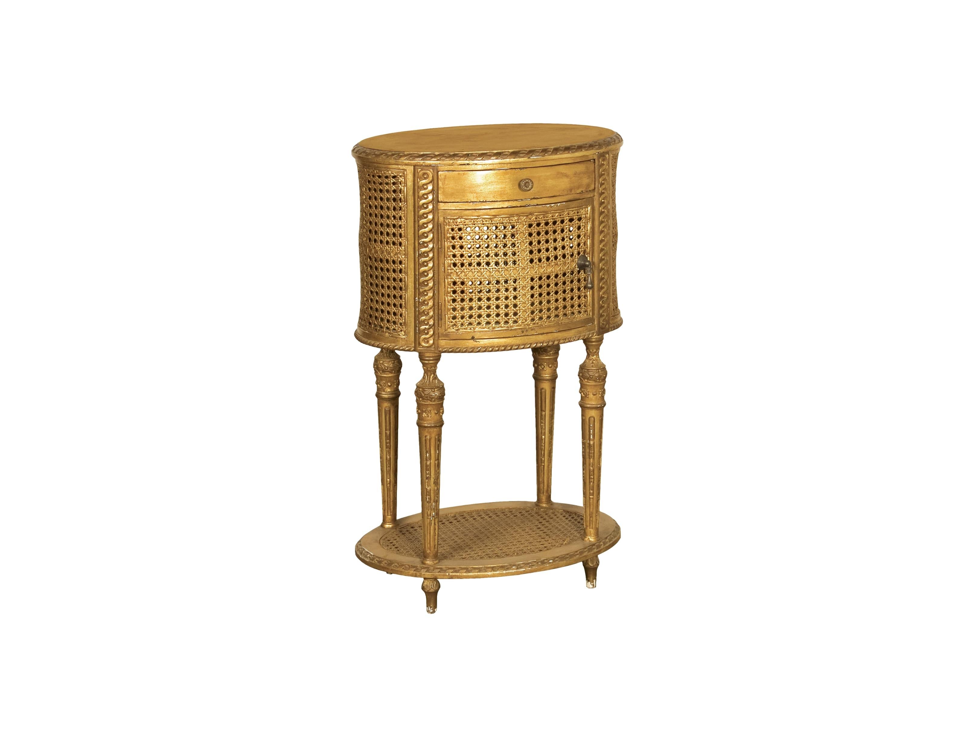 ТумбаПрикроватные тумбы, комоды, столики<br>Золотая прикроватная тумба, на изящных ножках, декорированная ротангом, с двумя ящиками.<br><br>Material: Красное дерево<br>Width см: 43<br>Depth см: 33<br>Height см: 73
