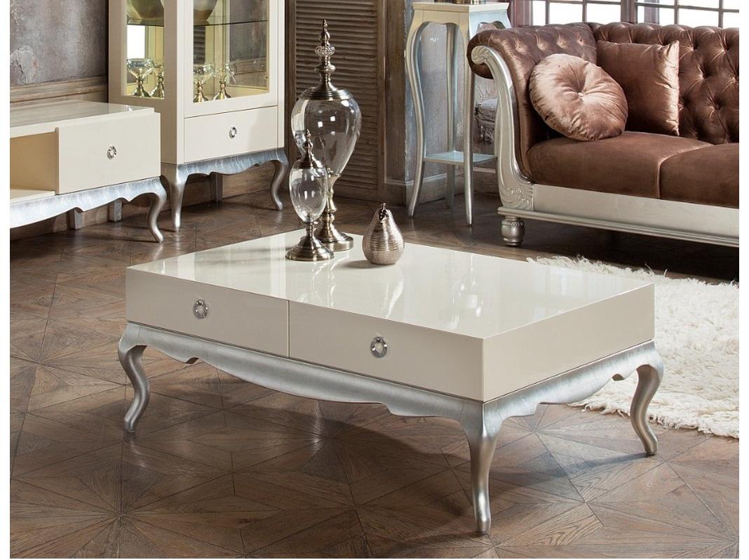 Журнальный стол VeneziaЖурнальные столики<br>Журнальный стол на гнутых ножках выполнен в классическом стиле. Отделка перламутровый кремовый лак, ножки и основание сусальное серебро.&amp;amp;nbsp;&amp;lt;div&amp;gt;Функционал дополнен 4 выдвижными ящиками - 2 слева, 2 справа.&amp;amp;nbsp;&amp;lt;/div&amp;gt;&amp;lt;div&amp;gt;Сделан из высококачественного МДФ высокой плотности и массива дерева.&amp;amp;nbsp;&amp;lt;/div&amp;gt;&amp;lt;div&amp;gt;Все выдвижные ящики снабжены направляющими.&amp;lt;/div&amp;gt;<br><br>Material: Дерево