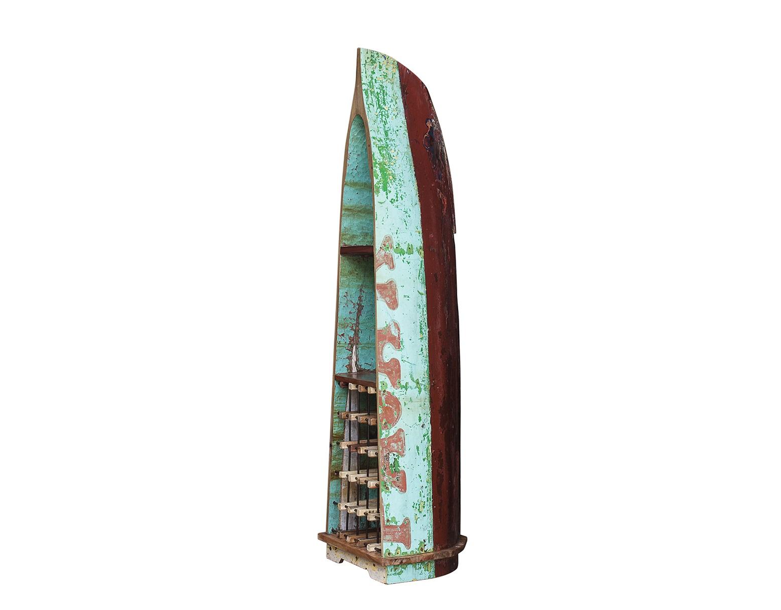 Винный шкаф МагелланВинные шкафы<br>Винный шкаф, выполненный из старой рыбацкой лодки классической правильной формы с сохранением оригинальной многослойной окраски.<br>Хранит до 15 бутылок. <br>Подходит для использования как внутри помещения, так и снаружи. <br>Сборка не требуется. <br>Покрытие: шеллак <br>Материал: массив тика (махогони, суара)<br><br>Material: Тик<br>Ширина см: 53.0<br>Высота см: 219.0<br>Глубина см: 59.0