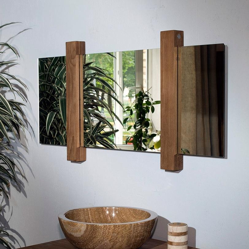 Зеркало MatahariНастенные зеркала<br>Эко-дизайн сегодня в неоспоримом тренде. Особенно органично этот стиль смотрится в ванной комнате, где к живой растительности и прочим натуральным материалам добавляется стихия воды. Именно для такого интерьера предназначено зеркало MATAHARI, выполненное из натурального тика. Отражающая поверхность свободно перемещается внутри деревянных перегородок, поэтому вы сами можете выбирать их расположение и менять внешний вид зеркала.<br><br>Material: Тик<br>Length см: None<br>Width см: 120.0<br>Depth см: 6.0<br>Height см: 60.0<br>Diameter см: None