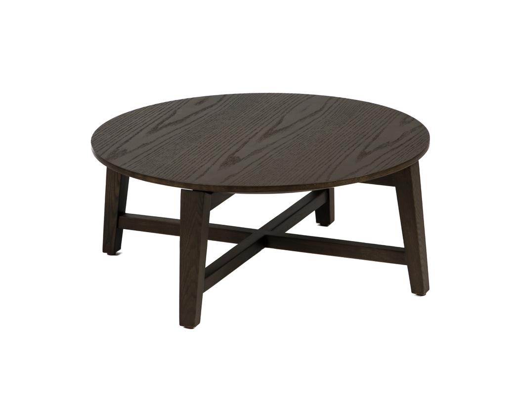 Журнальный столЖурнальные столики<br>Этот стол из темного дерева привлекает внимание своей нестандартной высотой. Он чуть ниже, чем традиционные модели, ведь его форма заимствована от классического табурета. Круглую столешницу держат четыре укороченные ножки-бруски, скрепленные дополнительными перекладинами. Такой столик станет &amp;quot;своим&amp;quot; в лофтовых и кантри пространствах или марокканском интерьере.<br><br>Material: Дерево<br>Length см: None<br>Width см: None<br>Height см: 26<br>Diameter см: 60