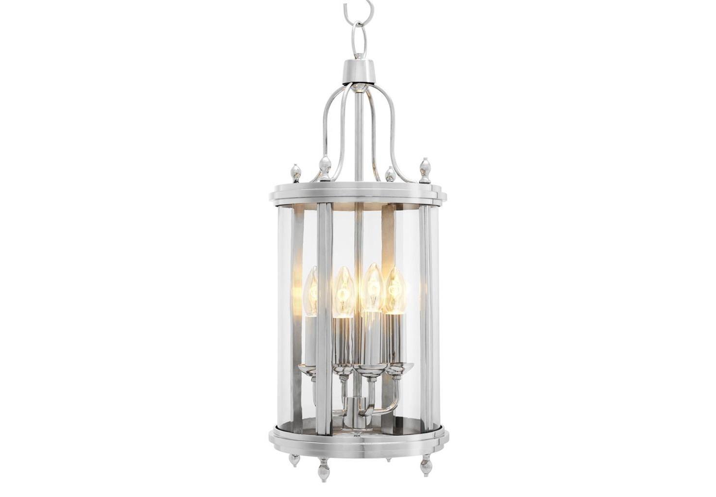 Подвесной светильник SandhurstПодвесные светильники<br>Светильник &amp;quot;Lantern Sandhurst&amp;quot; напоминает старинный фонарь, в элегантном стеклянном корпусе которого скрыто настоящее волшебство. Стоит только включить лампу, и вместе с мягким светом магия тут же распространится по комнате. Оформление пространства станет более уютным и теплым благодаря прованскому дизайну. Подвесив светильник к потолку или просто поставив его на стол, вы сможете придать своему дому скромное очарование французского шарма.&amp;lt;div&amp;gt;&amp;lt;br&amp;gt;&amp;lt;/div&amp;gt;&amp;lt;div&amp;gt;Количество лампочек: 4.&amp;lt;/div&amp;gt;&amp;lt;div&amp;gt;Мощность: 4x 40 Вт.&amp;lt;/div&amp;gt;&amp;lt;div&amp;gt;Тип лампы: накаливания, E14.&amp;lt;/div&amp;gt;<br><br>Material: Металл<br>Ширина см: 26<br>Высота см: 64<br>Глубина см: 26