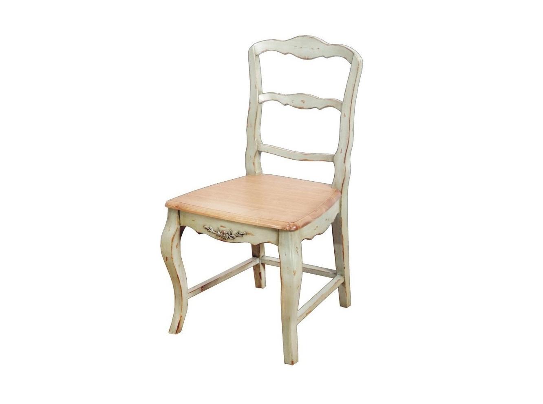СтулОбеденные стулья<br>Легкость и нежность выражены не только в светлой гамме этого стула, но и в изысканных пропорциях классического силуэта. Простоту и уютность добавляет патинирование. Завершает облик прекрасная цветочная деталь, придающая оформлению романтичное настроение.<br><br>Material: Дерево<br>Ширина см: 46<br>Высота см: 91<br>Глубина см: 46
