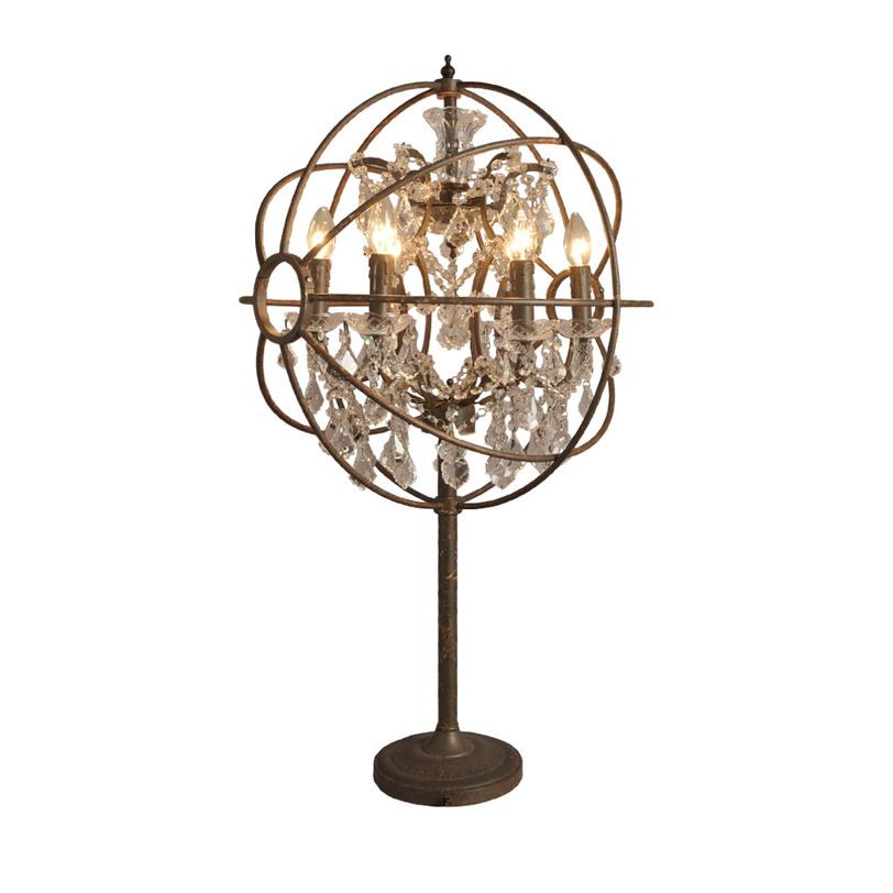 Лампа настольная IRON ORB TABLE LAMPДекоративные лампы<br>Настольная лампа в стиле ар-нуво. Сферический абажур из бронзового металла скрывает классическую форму осветительного прибора со свечами и стеклянными подвесками. Тонкая ножка опирается на круглое основание с едва заметным узором.<br><br>Material: Металл