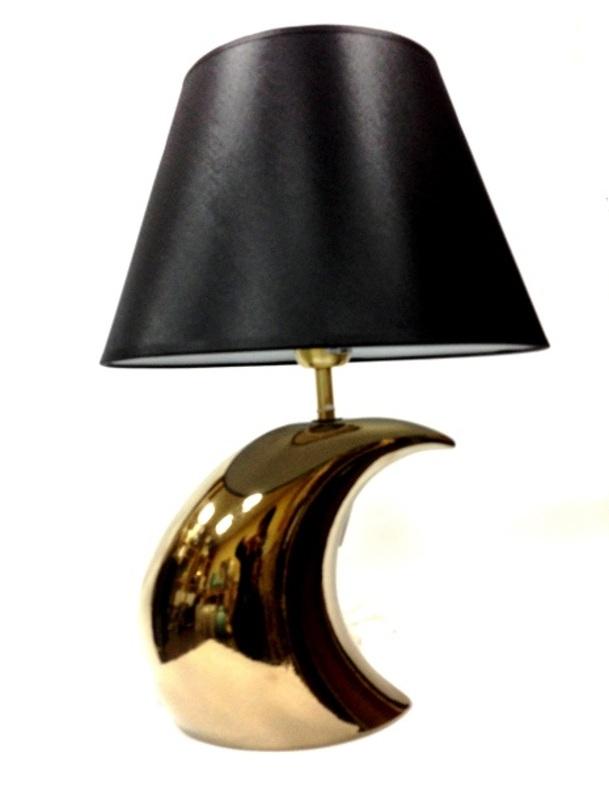 Настольная лампаДекоративные лампы<br>Настольная лампа из керамики в американском стиле. Основание напоминает форму полумесяца на фоне темного ночного неба, которое символизирует черный матовый абажур.&amp;lt;div&amp;gt;&amp;lt;br&amp;gt;&amp;lt;/div&amp;gt;&amp;lt;div&amp;gt;&amp;lt;div&amp;gt;Вид цоколя: E27&amp;lt;/div&amp;gt;&amp;lt;div&amp;gt;Мощность: 60W&amp;lt;/div&amp;gt;&amp;lt;div&amp;gt;Количество ламп: 1&amp;lt;/div&amp;gt;&amp;lt;/div&amp;gt;<br><br>Material: Керамика<br>Length см: None<br>Width см: None<br>Depth см: None<br>Height см: 44.0<br>Diameter см: None