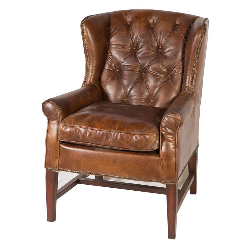 Кресло из кожиКожаные кресла<br>Кожаное кресло с «ушами» в классическом английском стиле. Спинка декорирована «пуговичной» стёжкой, мягкое сиденье и низкие закруглённые подлокотники располагают к отдыху. Кожа коньячного цвета слегка «состарена», и этот «налёт времени» придаёт модели благородство. Кресло декорировано «металлической строчкой», подчёркивающей силуэт. Видимая часть каркаса выполнена в цвете, который абсолютно точно повторяет тон обивки.<br><br>Material: Кожа<br>Width см: 87<br>Depth см: 77<br>Height см: 102