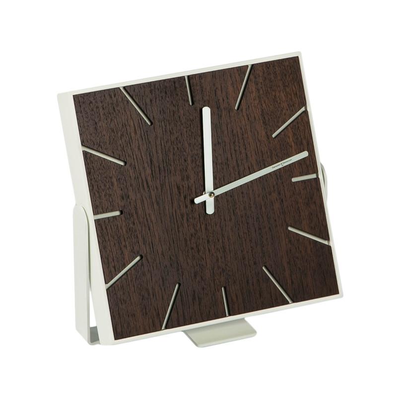 Настольные часы SNAPНастольные часы<br>Настольные часы от итальянских дизайнеров модного цвета венге цвета выполнены в минималистичном стиле - ровные геометрические линии, прямые углы, монохромный циферблат, полное отсутствие какого-либо декора. Подойдет как для домашних помещений - кухни, гостиной, спальни, так и для рабочих - офиса или креативной студии, оформленных в современном стиле лофт.<br><br>Material: Металл<br>Length см: None<br>Width см: 28<br>Depth см: 3<br>Height см: 28