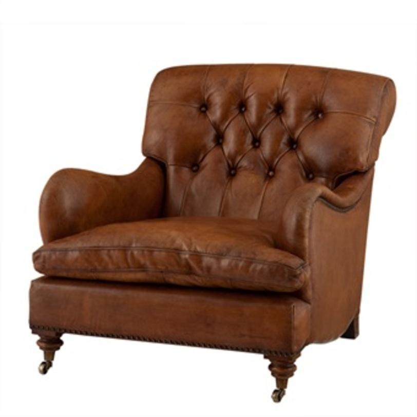 Кресло Club CaledonianКожаные кресла<br>Статное кресло с подлокотниками из натуральной кожи коньячного оттенка. Классический стиль сможет завершить или стать акцентом, как гостиной, так и рабочего кабинета. Удобное и комфортное сиденье располагает к тому, чтобы проводить в нем все свободное время. Передние ножки оснащены не большими колесиками.<br><br>Material: Кожа<br>Length см: None<br>Width см: 75<br>Depth см: 70<br>Height см: 76