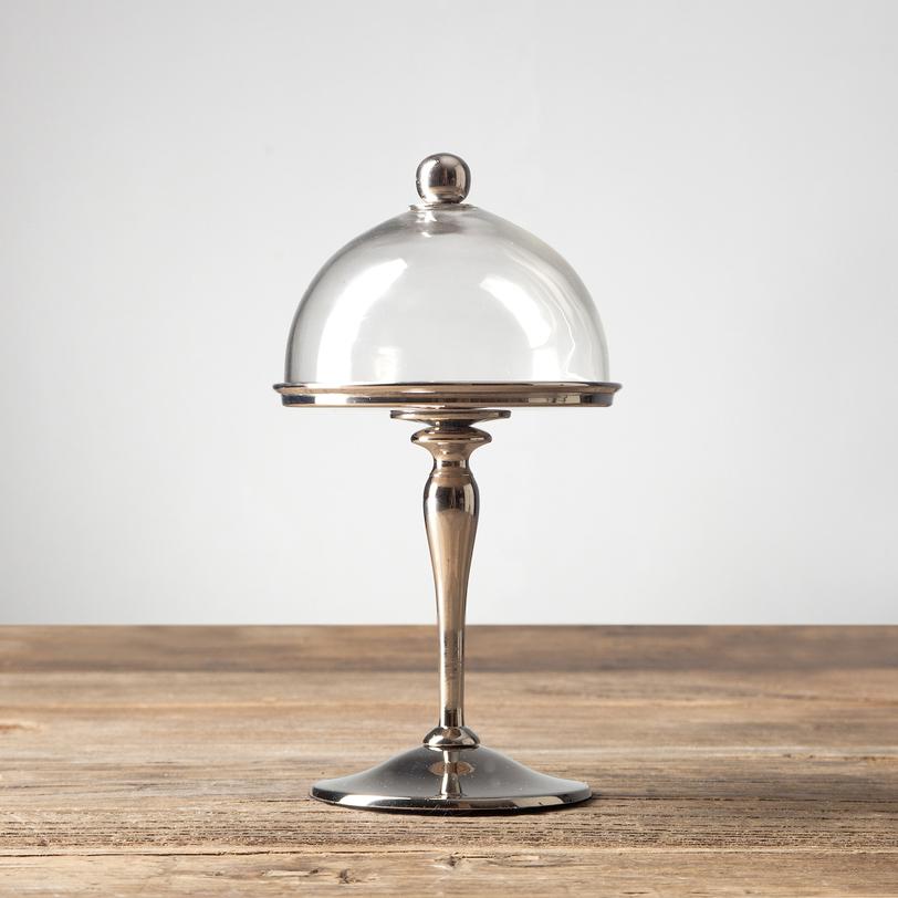 Чаша с крышкойПодставки и доски<br>Этот элегантный стеклянный сосуд может служить хлебницей или конфетницей. А в особо торжественных случаях можете поставить в него небольшую широкую свечу, с помощью которой создадите в доме романтическую атмосферу.<br><br>Material: Стекло<br>Height см: 23<br>Diameter см: 12