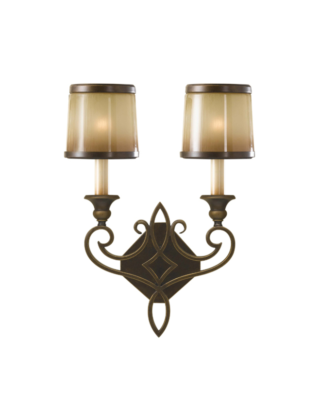 Бра Justine Astral BronzeБра<br>Настенный светильник-бра из бронзы. Каркас украшен готическим средневековым узором и непрозрачными плафонами, имитирующими неяркий свет от зажженных свечей.<br><br>Мощность: 2x E14 60W<br><br>Material: Бронза<br>Width см: 33.7<br>Depth см: 14<br>Height см: 43.5