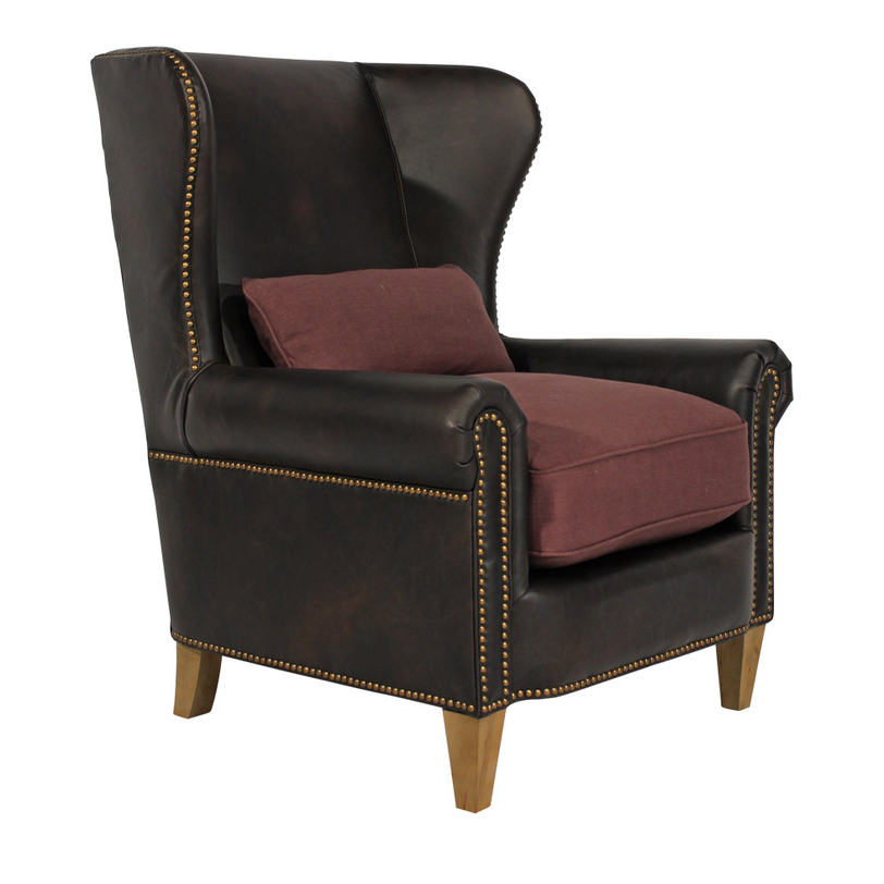 Кресло Malonne ArmchairКожаные кресла<br>Классическое каминное кресло &amp;quot;с ушами&amp;quot;. Обтянуто натуральной кожей, каркас выполнен из дерева – что можно придумать традиционнее? Подушки сиденья обиты тканью – даже летом на таком кресле будет приятно сидеть. Завершают образ гирлянды медных гвоздиков, окантовывающие кресло, придающие виду приятный акцент.<br><br>Material: Кожа<br>Width см: 94<br>Depth см: 90<br>Height см: 109