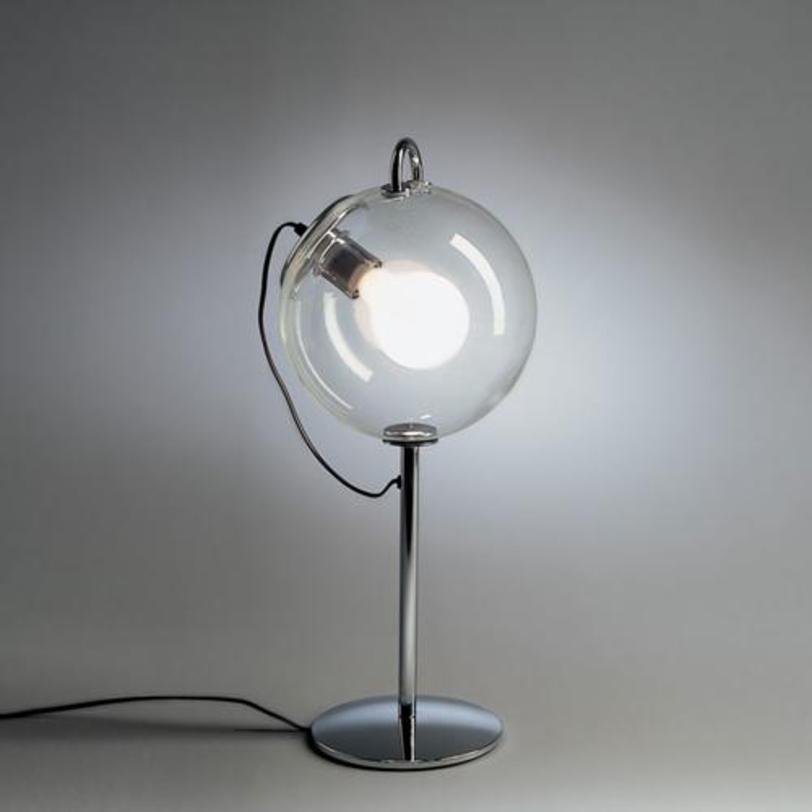 Настольная лампа Miconos tavoloДекоративные лампы<br>Выполнена из полированного хромированного металла, плафон из прозрачного выдувного стекла. Комплектуется диммером.<br><br>Мощность: 1 Е27 x 20 Вт<br><br>Material: Стекло<br>Height см: 60.0<br>Diameter см: 25.0