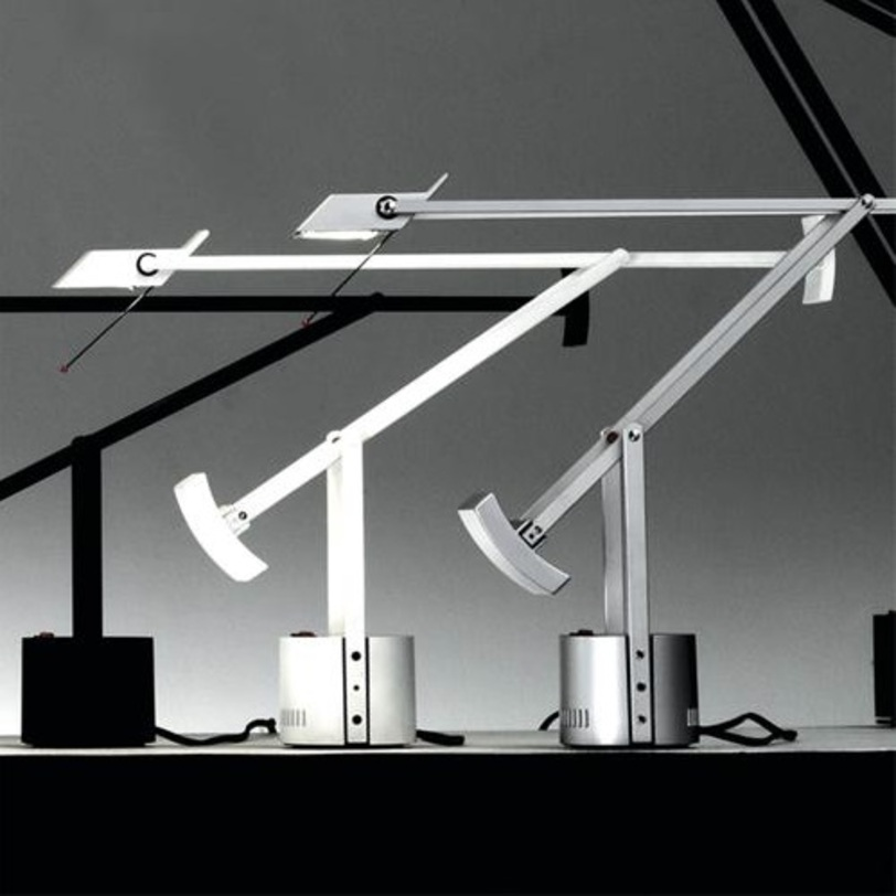 Настольная лампа Tizio micro WhiteНастольные лампы<br>Настольная лампа &amp;quot;Tizio micro White&amp;quot; выполнена из поликарбоната окрашенного в белый цвет. Противовес устанавливается в нескольких положениях, позволяя менять угол наклона и высоту от 23 до 76 см. Инновация Tizio в его конструкции: трансформатор находится в основании и питает галогенную лампу через рейки и клепки самой конструкции без дополнительных проводов.&amp;lt;div&amp;gt;&amp;lt;div&amp;gt;Тип лампы: галогенная&amp;lt;/div&amp;gt;&amp;lt;div&amp;gt;Цоколь: G4&amp;lt;/div&amp;gt;&amp;lt;div&amp;gt;Мощность: 20W&amp;lt;/div&amp;gt;&amp;lt;/div&amp;gt;<br><br>Material: Пластик<br>Ширина см: 49<br>Высота см: 43