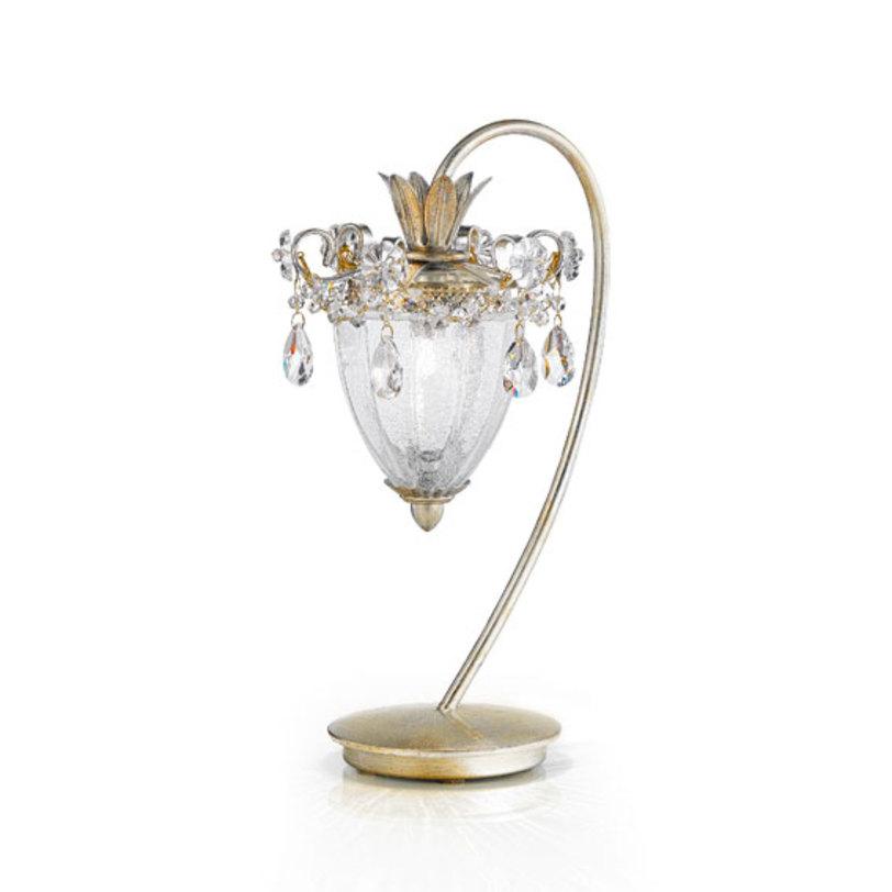 Настольная лампа RugiadaДекоративные лампы<br>Настольная лампа серии RUGIADA имеет металлическую основу покрытую фольгированным золотом. Элегантный плафон выполнен из муранского стекла ручной выдувки. Световой элемент один. Лампа декорирована цепочками и подвесками из прозрачного хрусталя.<br><br>Мощность: 1 G9 x 60 Вт<br><br>По индивидуальному заказу возможны различные модификации и варианты отделки.<br><br>Material: Металл<br>Height см: 40<br>Diameter см: 25