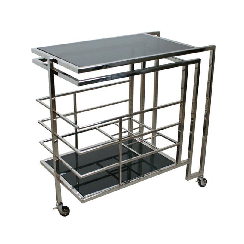 Столик ZumaСервировочные столики<br>Вглядываясь в хитросплетения металлических конструкций этого стола, можно предположить, что его силуэт был вдохновлен формами инженерных коммуникаций. Одновременно с этим предмет лишен чрезмерной небрежности, что делает его подходящим и для классических интерьеров в американском стиле и для более &amp;quot;простецких&amp;quot; лофтов.&amp;lt;div&amp;gt;&amp;lt;br&amp;gt;&amp;lt;/div&amp;gt;&amp;lt;div&amp;gt;Столик на колесах из никелированного металла. Столешница из плотного стекла.&amp;lt;/div&amp;gt;<br><br>Material: Металл<br>Length см: 77<br>Depth см: 42<br>Height см: 77