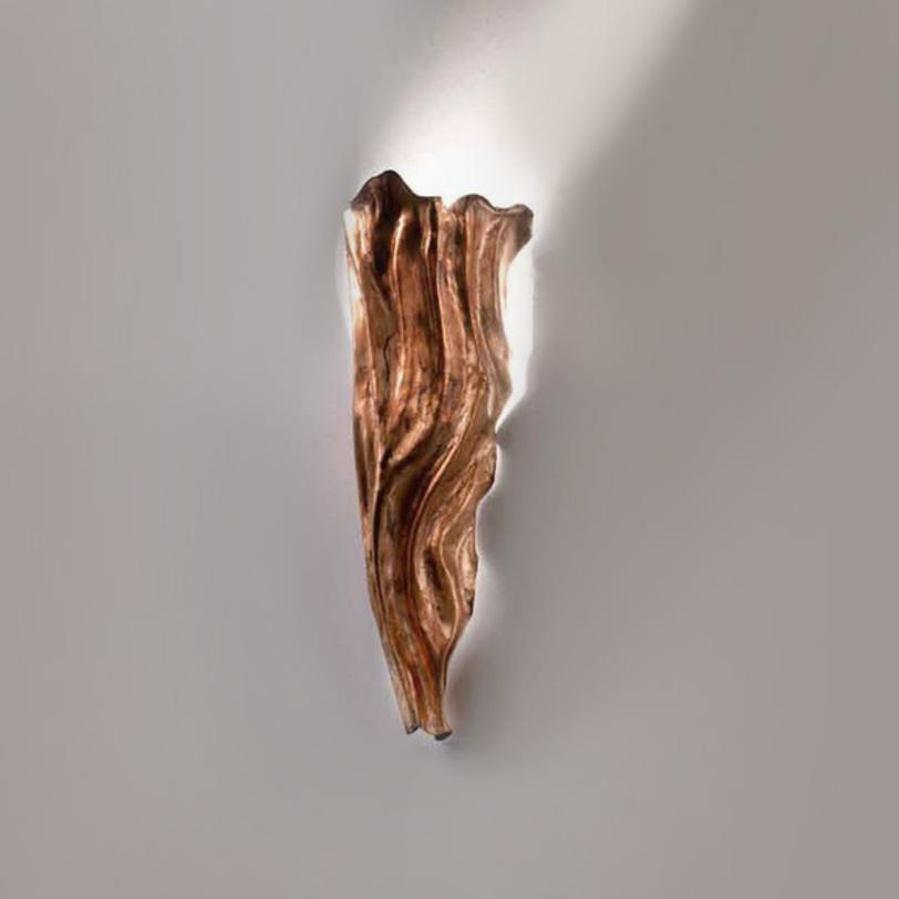 Бра TorceБра<br>Настенный светильник выполнен из кованного металла с имитацией ткани со складками.<br><br>Цвет: бронзовый с оранжевыми разводами.<br>Мощность: 1x 60 Вт, G9<br><br>Material: Металл<br>Width см: 18<br>Depth см: 11<br>Height см: 41