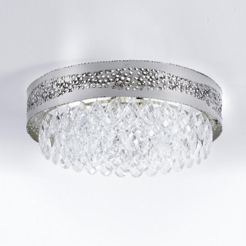Люстра HolesЛюстры потолочные<br>Потолочный светильник серии HOLES выполнен в стиле модерн. Рассеиватель металлический хромированный с оригинальной отделкой поверхности: россыпь отверстий, сквозь которые струятся потоки света. Светильник декорирован подвесками-кулонами из прозрачного хрусталя Swarovski.<br><br>Мощность: 3X MAX 60W E14<br><br>Material: Стекло<br>Height см: 21<br>Diameter см: 47