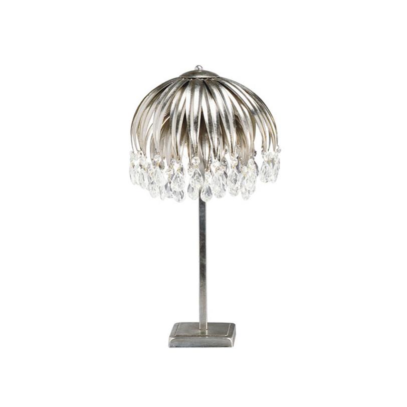 Настольная лампаДекоративные лампы<br>Настольная лампа из металла серебряного цвета. Светильник выполнен в виде цветка с ниспадающими лепестками. Хрустальные прозрачные подвески на конце лепестков. Дизайн: Karen Lenz.<br><br>Количество лампочек: 3<br>Мощность: 3 x 20 Вт<br>Тип лампы: Галогенные, G9<br><br>Material: Металл<br>Height см: 50.0<br>Diameter см: 28.0