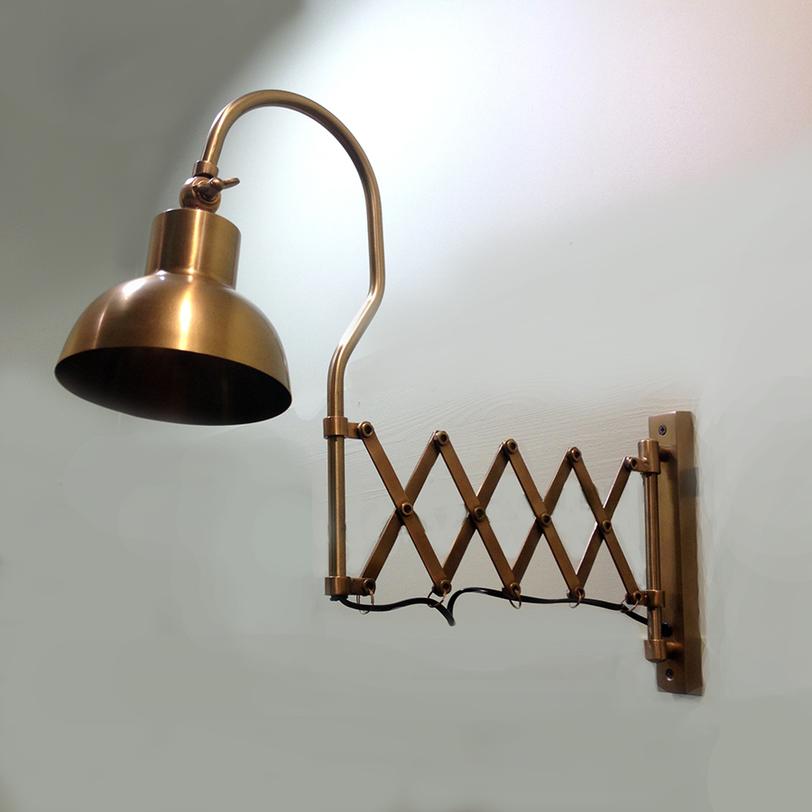 Светильник настенный HaroldБра<br>Настенный светильник из латуни оригинальной конструкции. Достоин внимания ценителя необычных и, в то же время, функциональных вещей.<br><br>Цоколь: Е-14, max 25W<br><br>Material: Латунь<br>Length см: None<br>Width см: 58<br>Depth см: 16<br>Height см: 42<br>Diameter см: None
